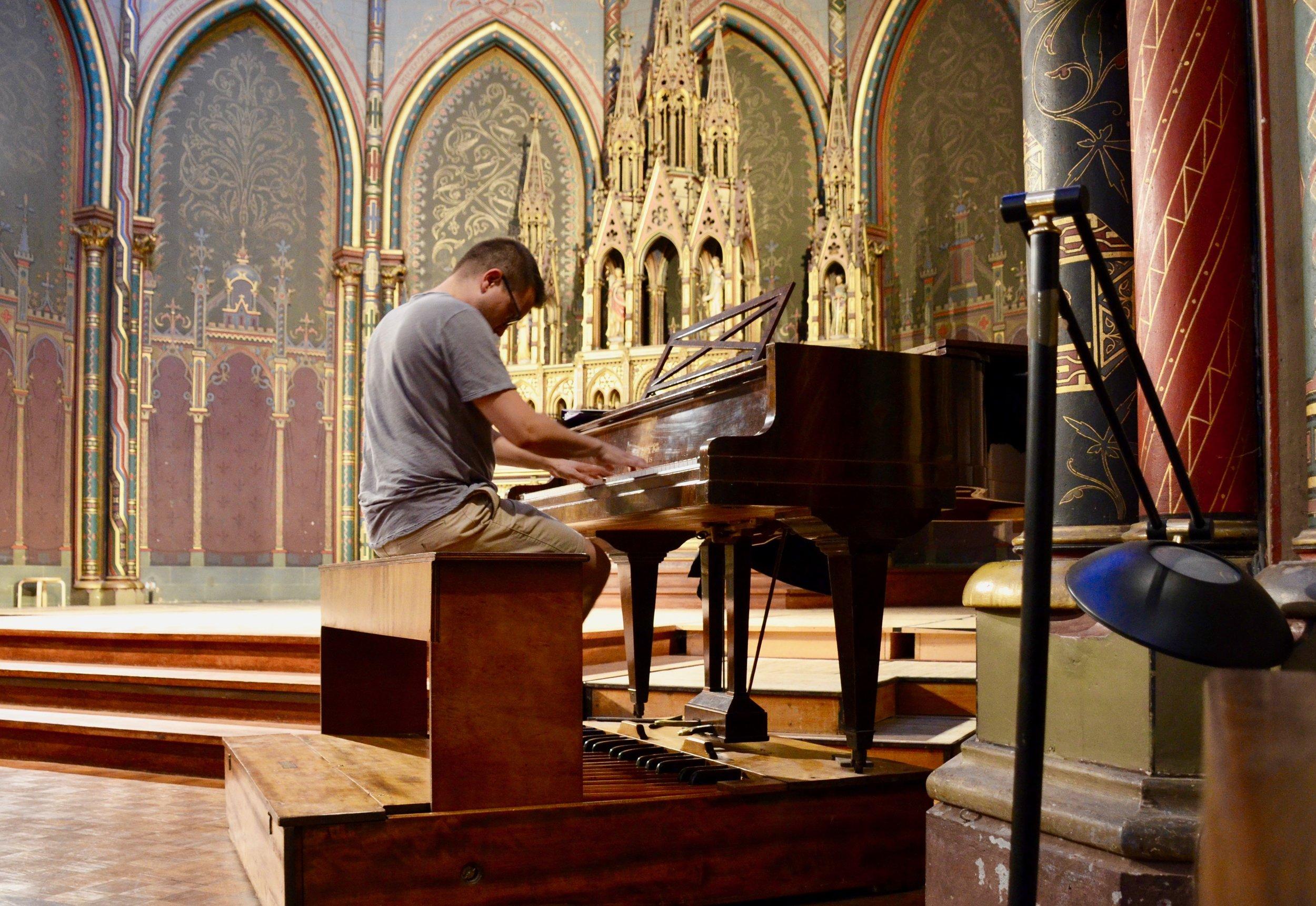 Corey de Tar tries out the pedal piano.