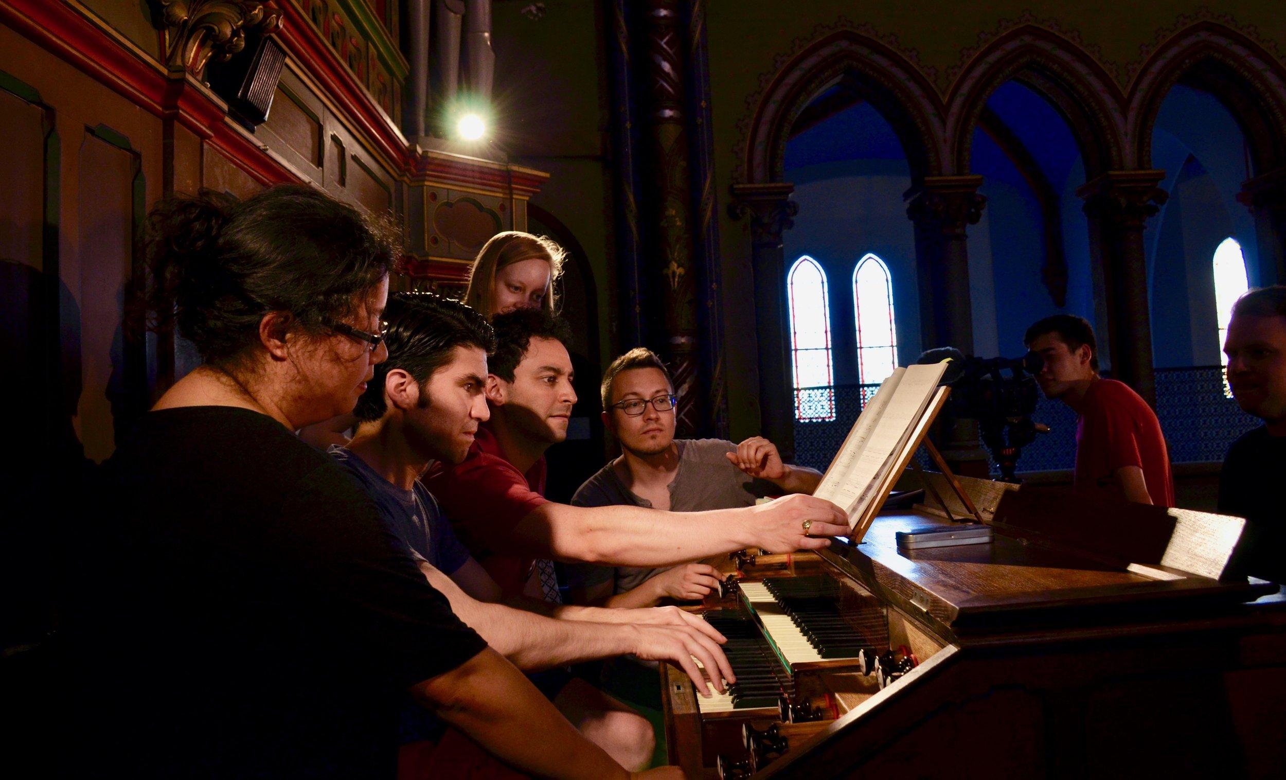 Members of Boston Organ Studio try out the organ in Gésu Church