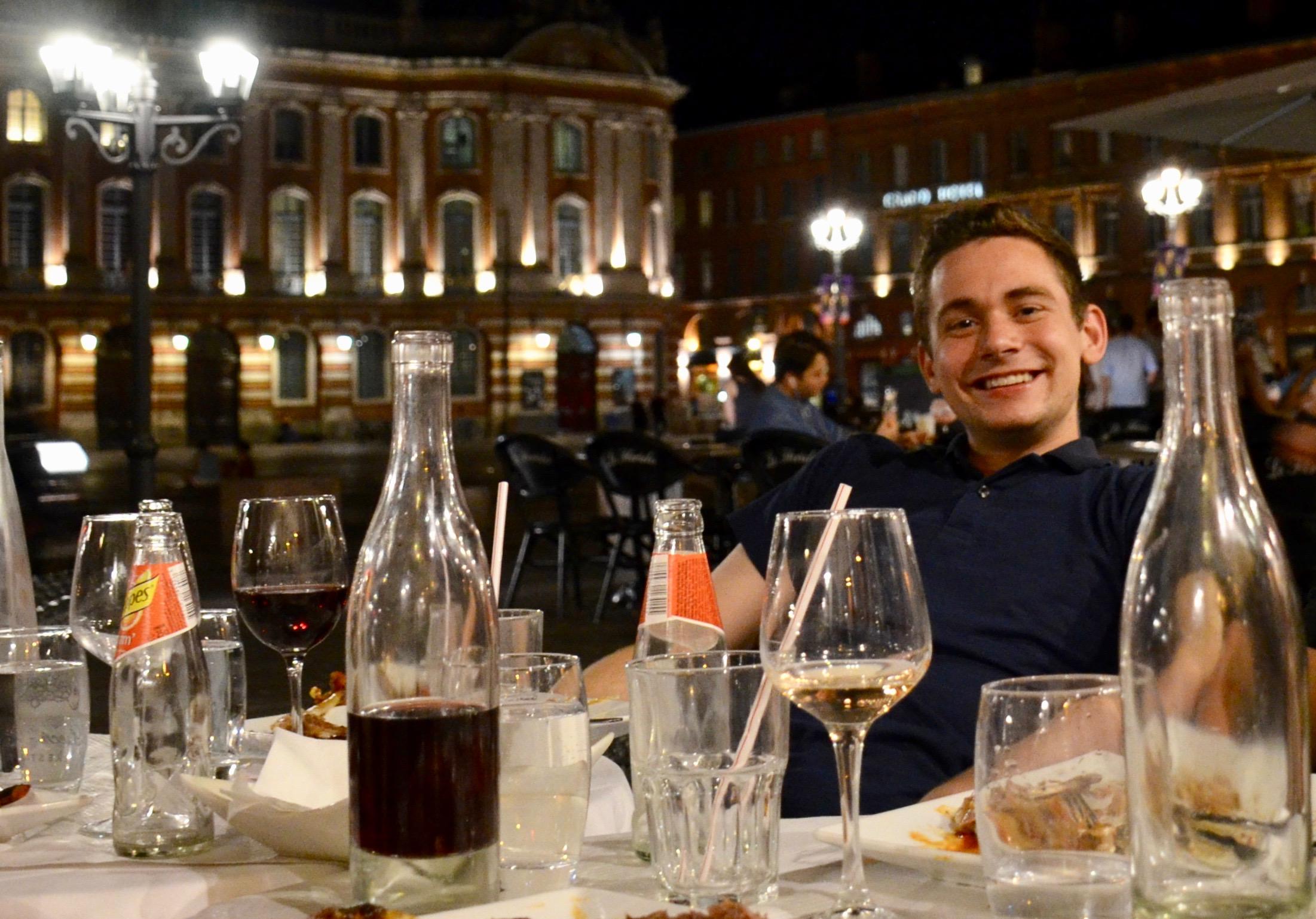 David von Behren enjoying a meal in the square