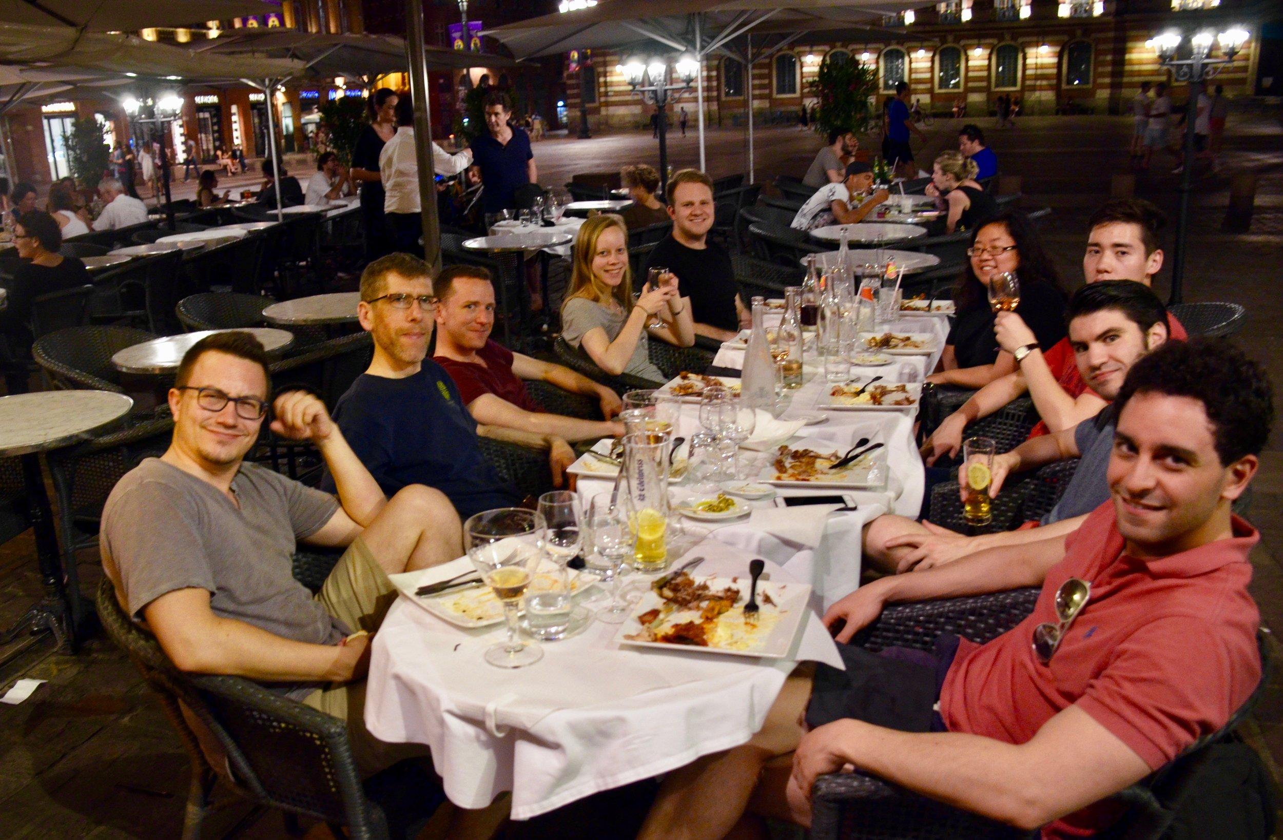 Boston Organ Studio members enjoy dinner on the square in Toulouse.