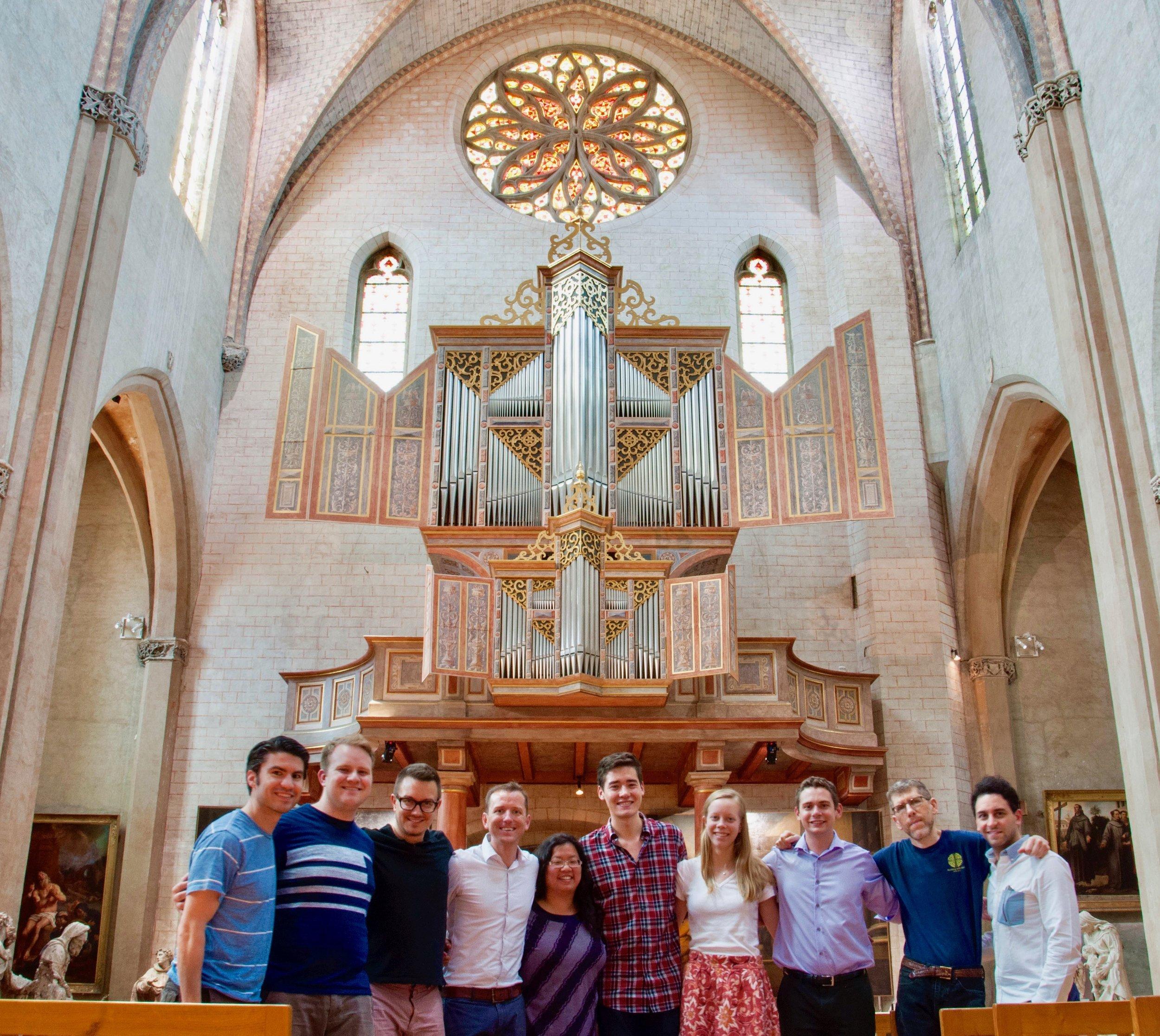 Boston Organ Studio members pose before the Ahrend organ in Toulouse.