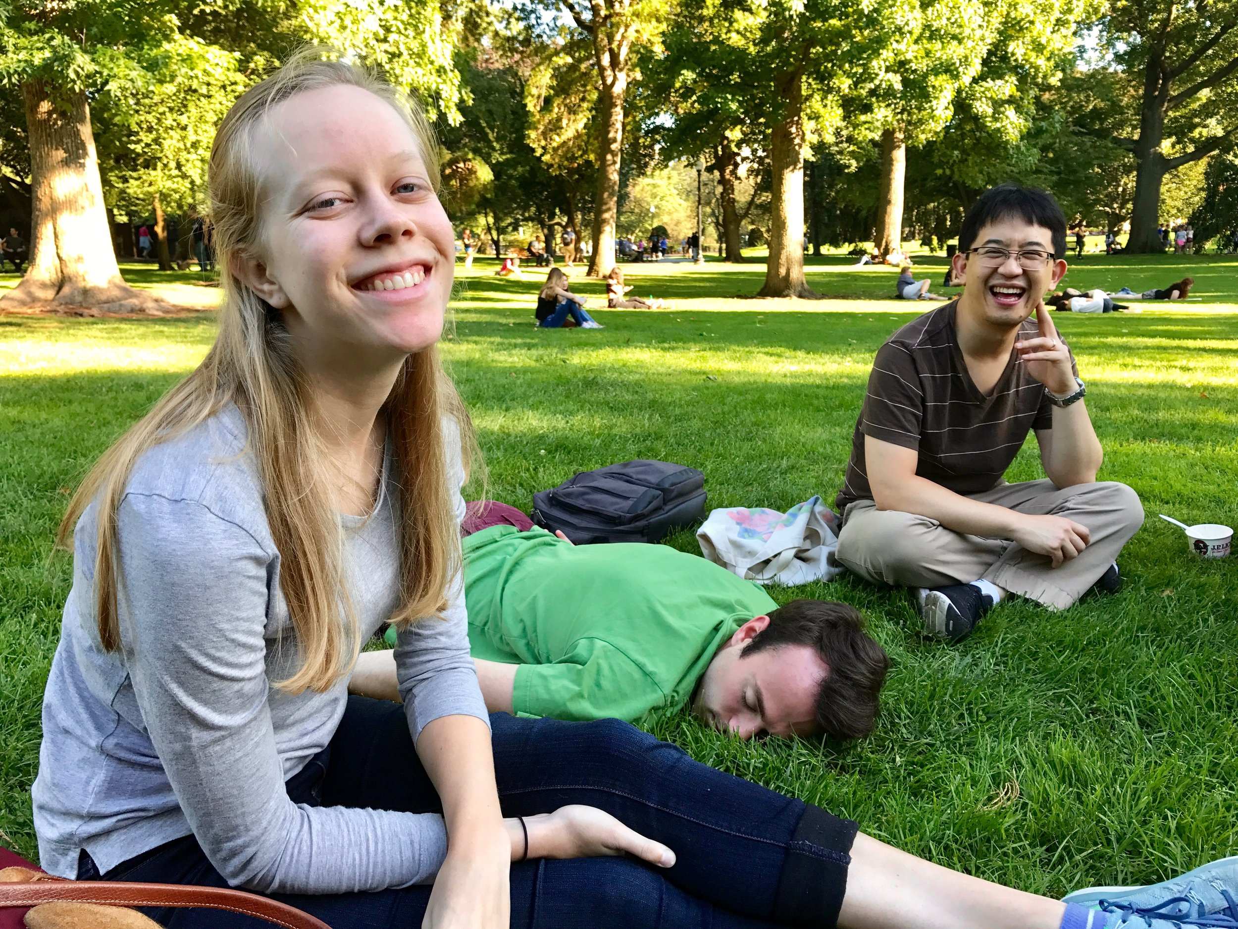 Laura Gullett and Emerson Fang enjoy the sun in Boston Public Garden.