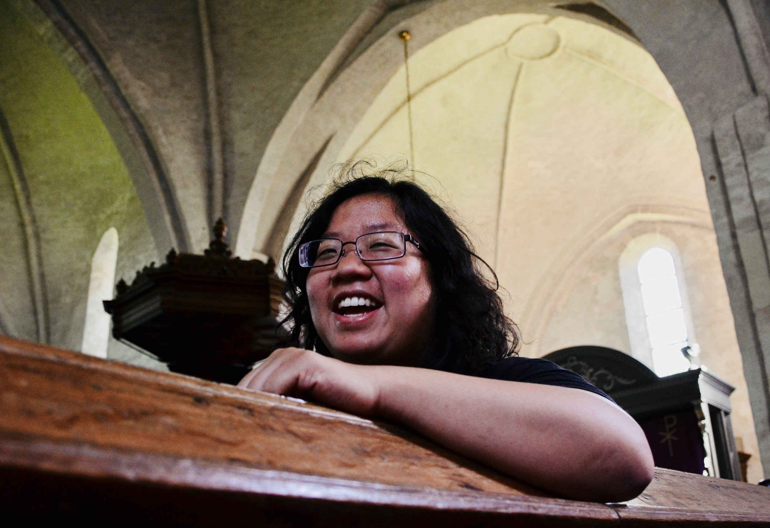 Jennifer Hsiao is all smiles listening to the 1733 Hinsz organ, Leens, Holland.