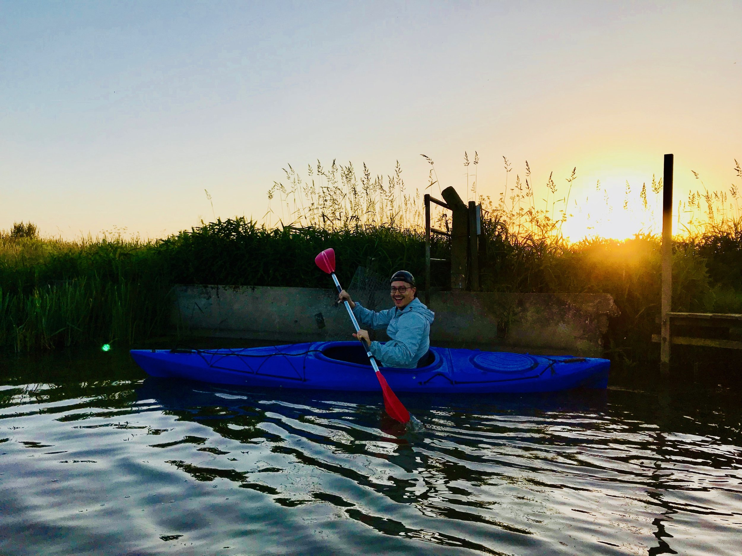Corey De Tar kayaking at our Airbnb in Holland!
