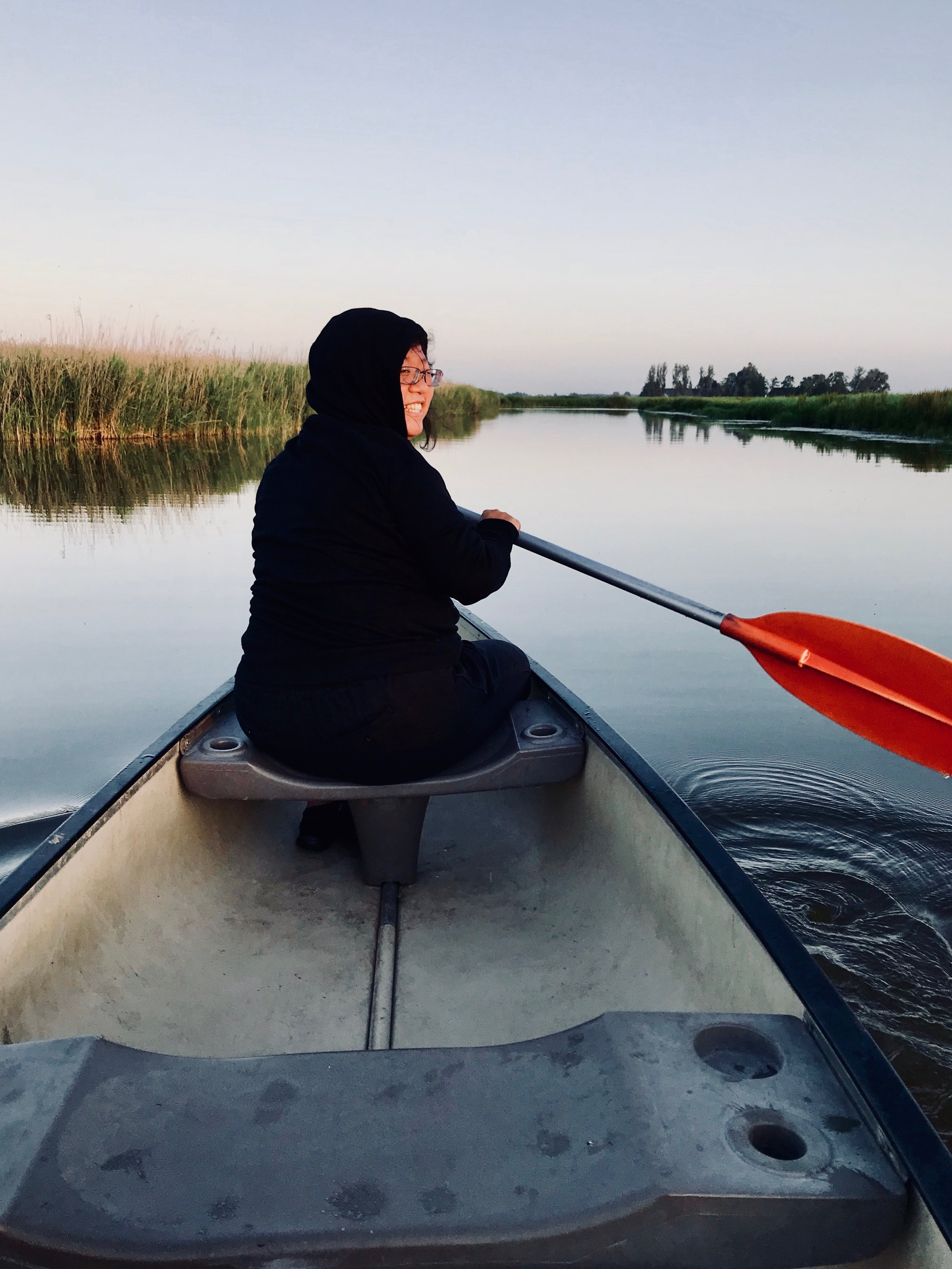 Jennifer Hsiao canoeing on the canal in Holland.