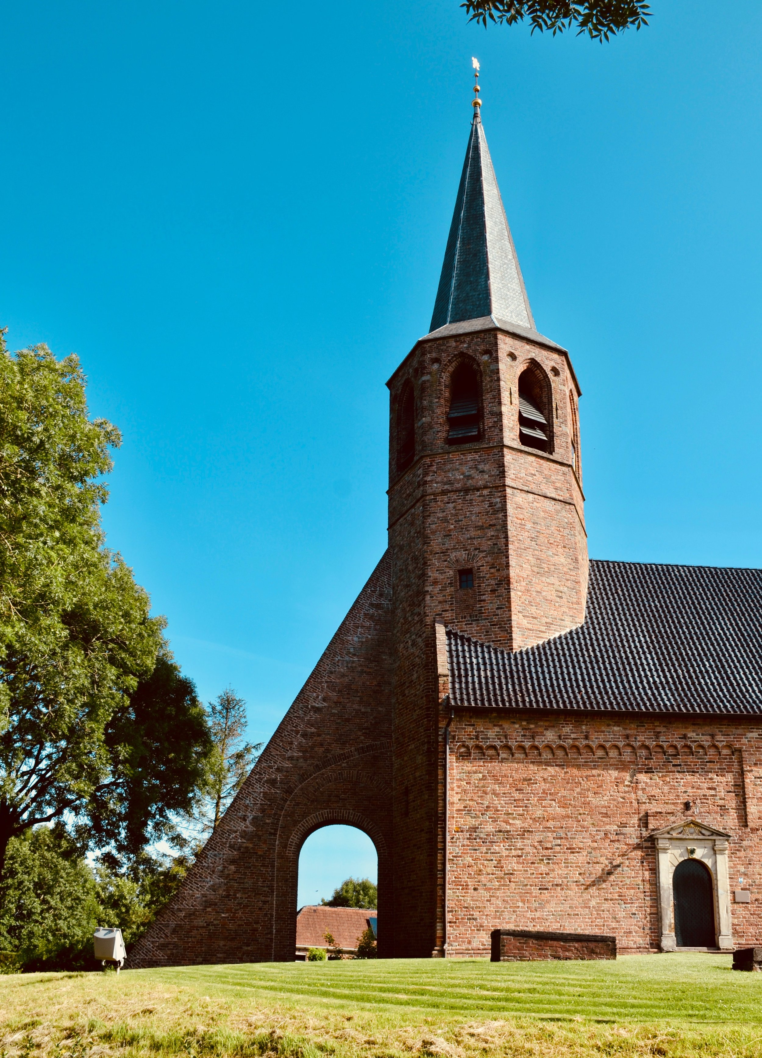The village church in Kantens, Holland, with an indiscreet tower support.
