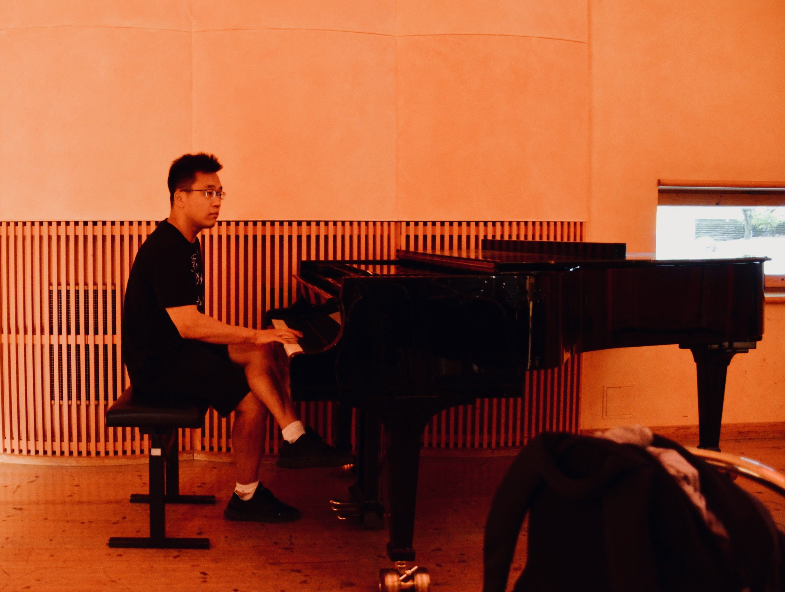 Adrian Cho plays the Steinway piano in Artisten, as part of improvisations with organ and choir (members of Boston Organ Studio).
