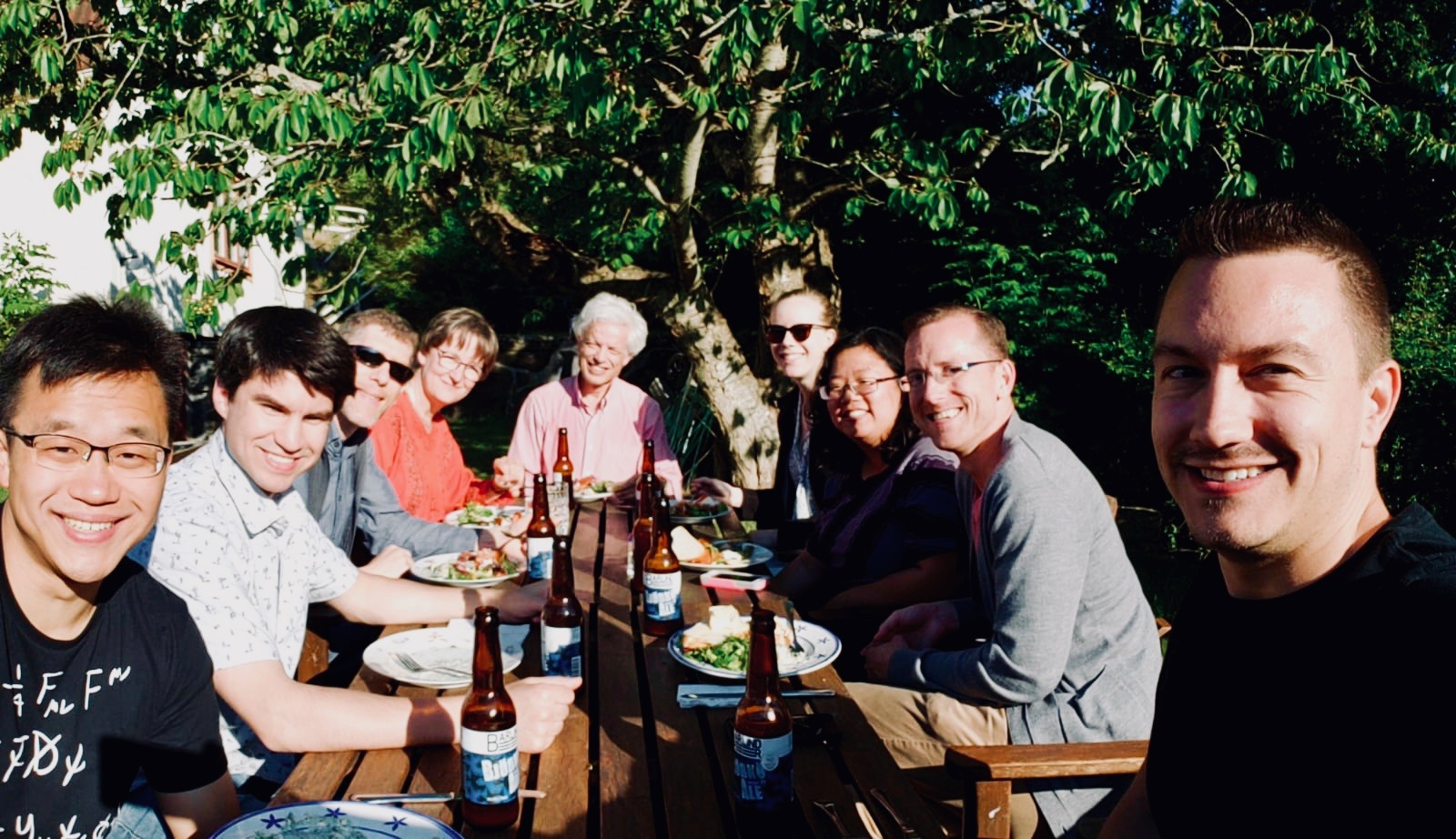 Members of Boston Organ Studio, with Hans and Ulrika Davidsson, enjoying an evening meal in the garden.