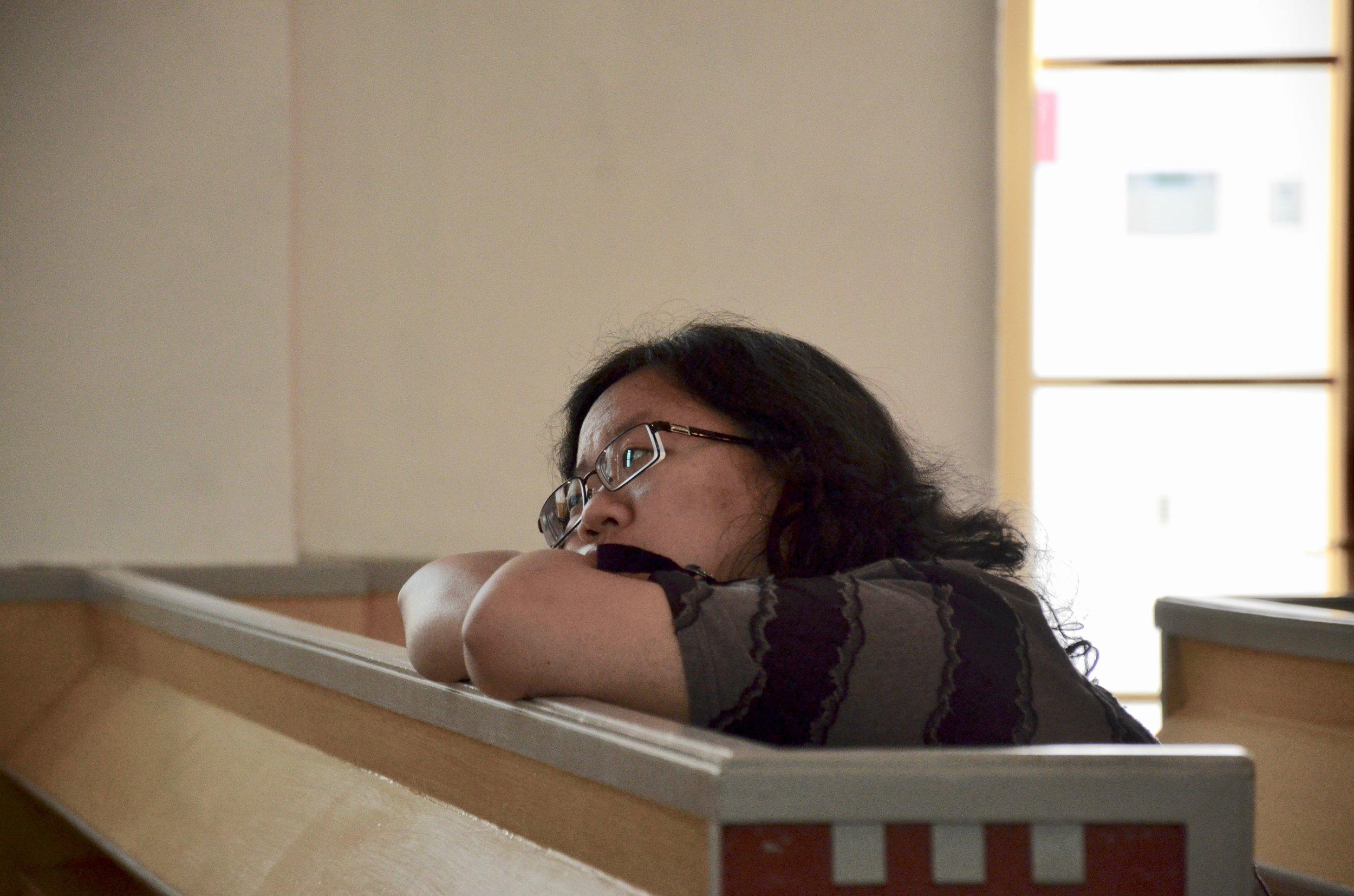 Jennifer Hsiao listens to the sounds of the 1783 Schiörlin organ in Jonsered, Sweden.