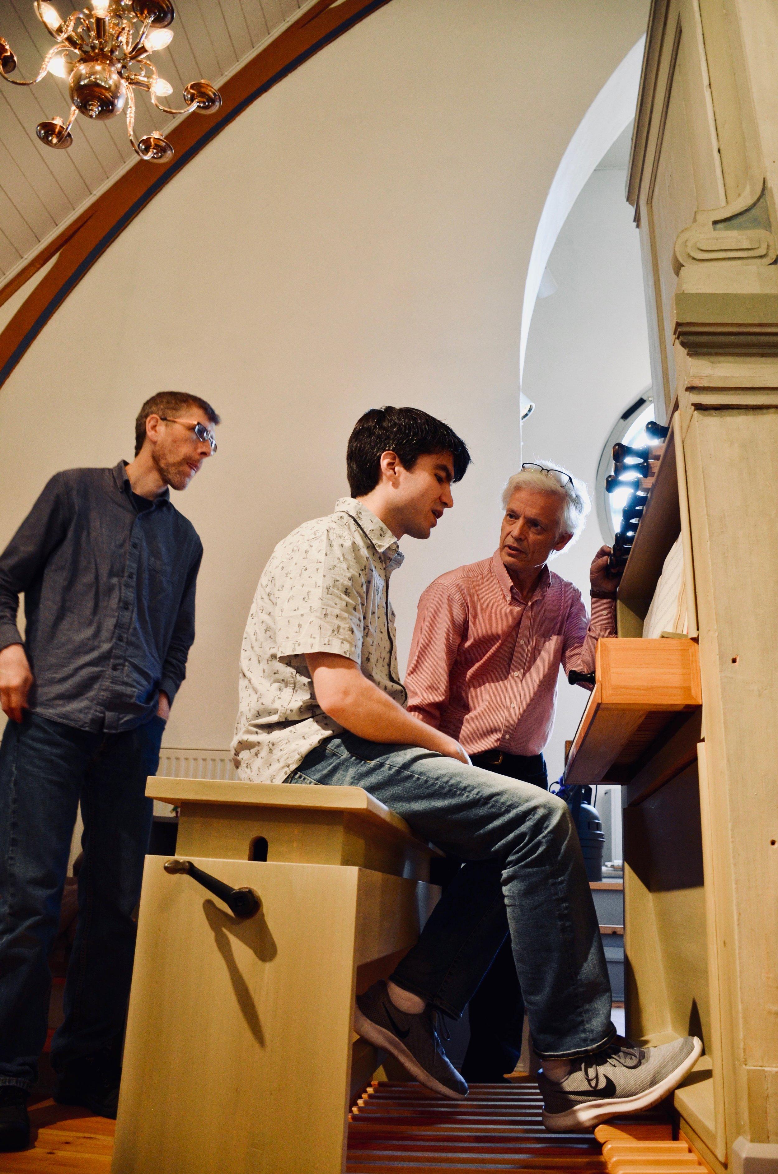 Hans Davidsson coaches Brandon Santini on the 1783 Schiörlin organ in Jonsered, Sweden.