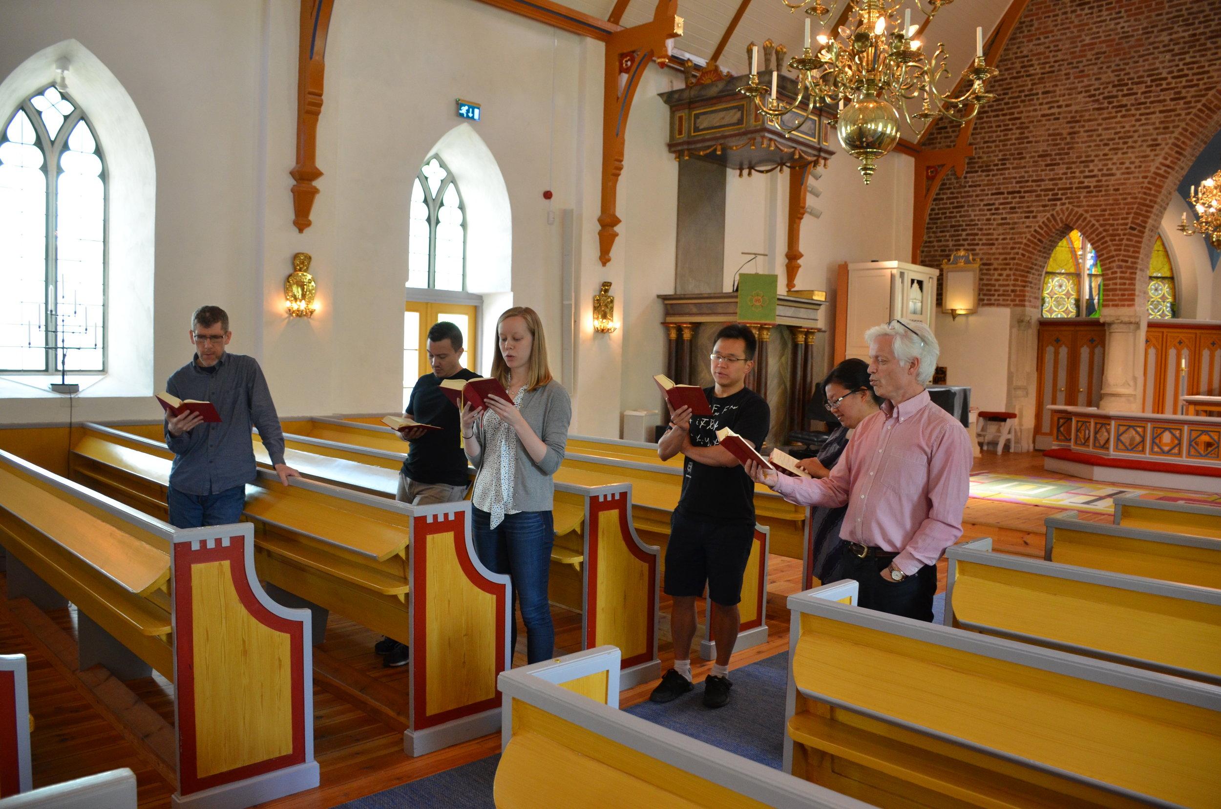 Members of Boston Organ Studio sing a hymn, with the 1783 Schiörlin organ in Jonsered, Sweden.