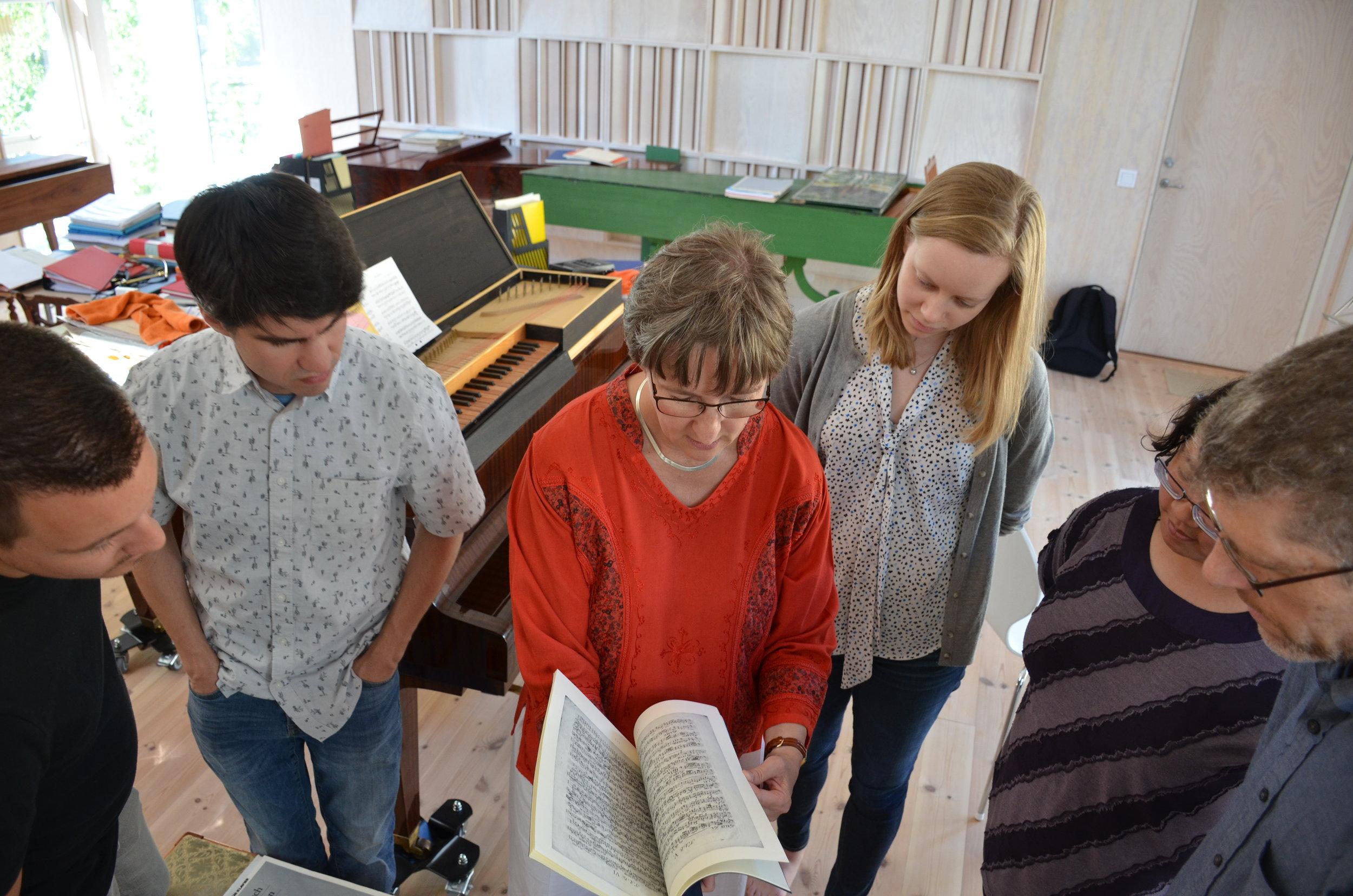 Ulrika Davidsson shows manuscript facsimile of music of C.P.E. Bach.