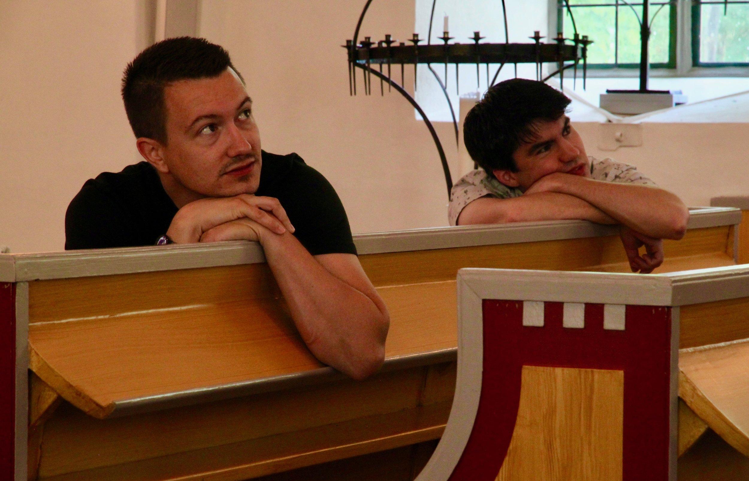 Brandon Santini and Corey De Tar listen intently.