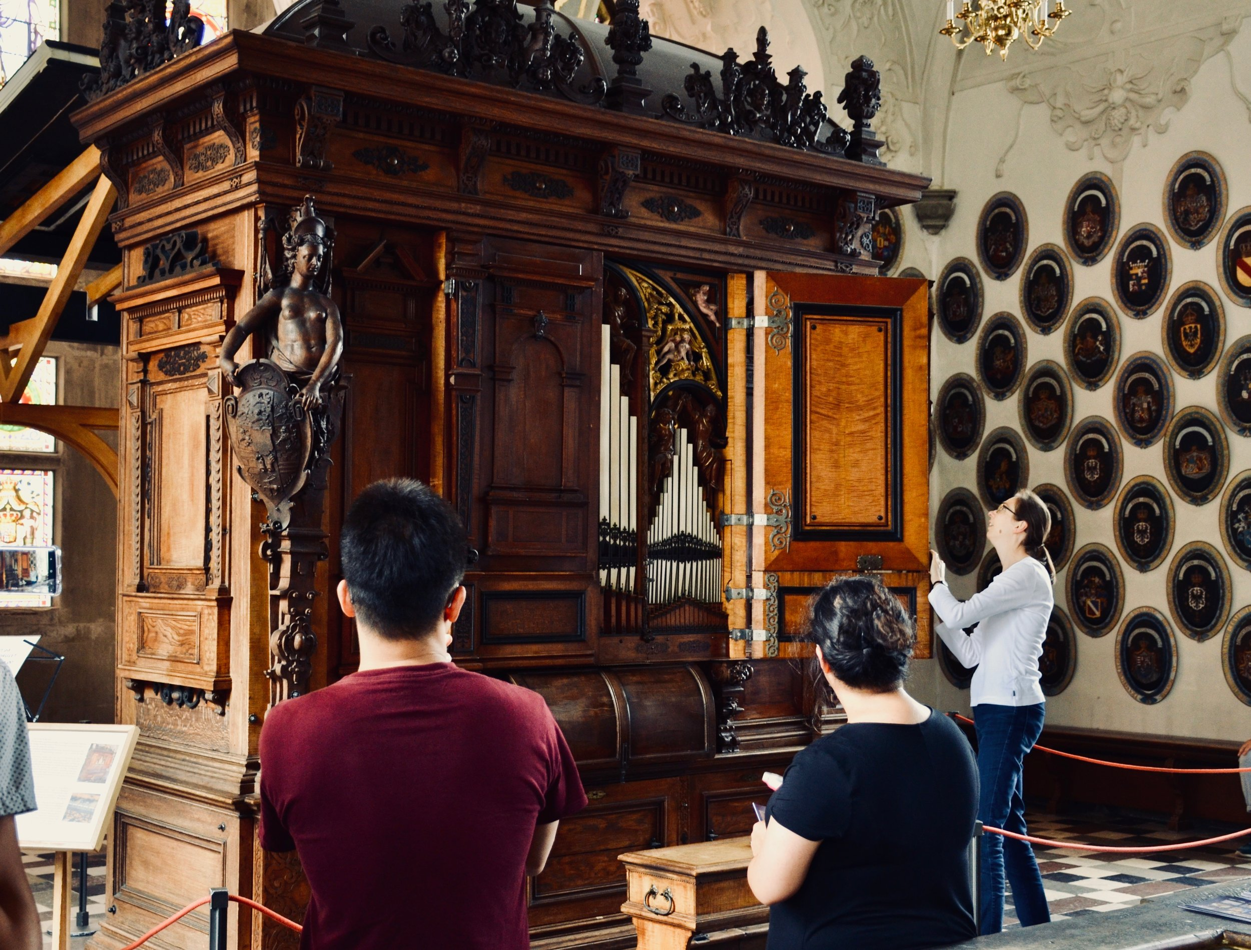 Castle organist Bine Bryndorf unlocks the 1610 Compenius organ, Frederiksborg Castle, Hillerød, Denmark.