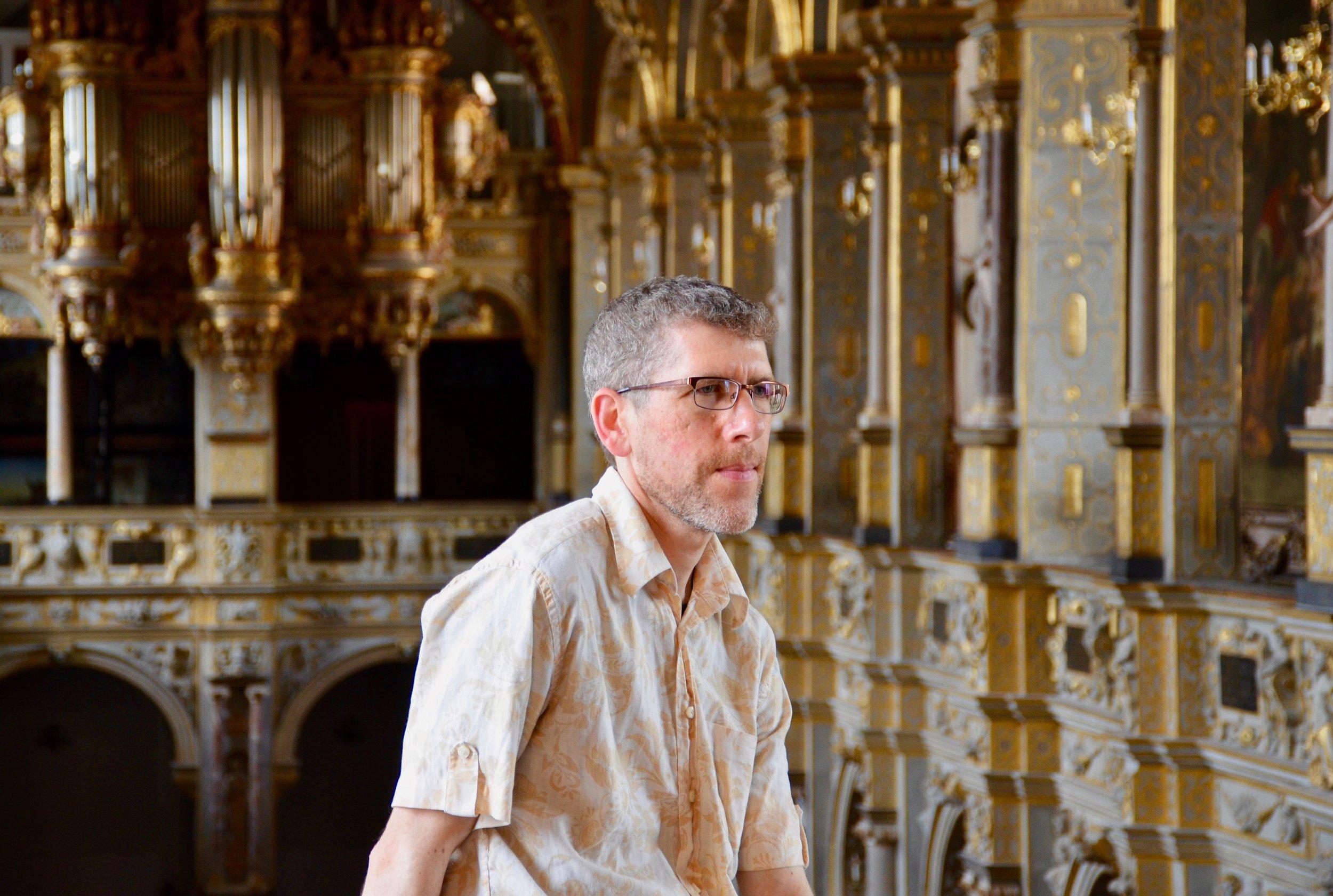 Chris Porter listens to the 1610 Compenius organ, Frederiksborg Castle, Hillerød, Denmark.