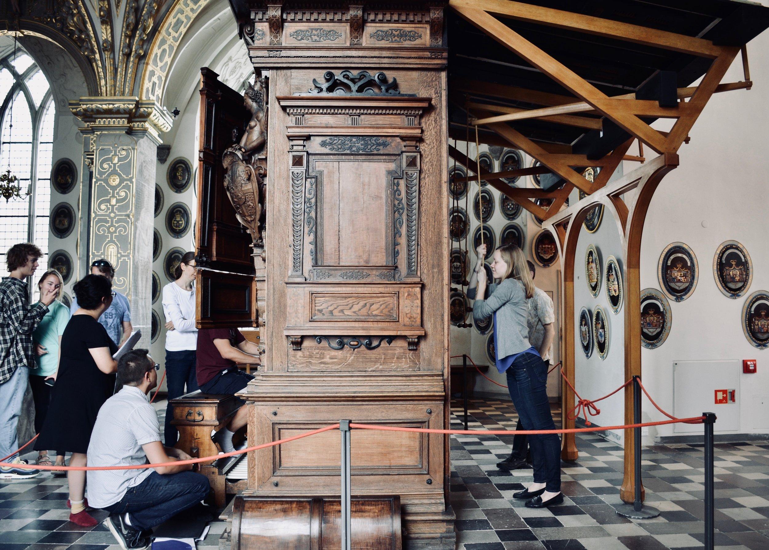 Pumping the bellows,Castle organist Bine Bryndorf coaches Adrian Cho, 1610 Compenius organ, Frederiksborg Castle, Hillerød, Denmark.