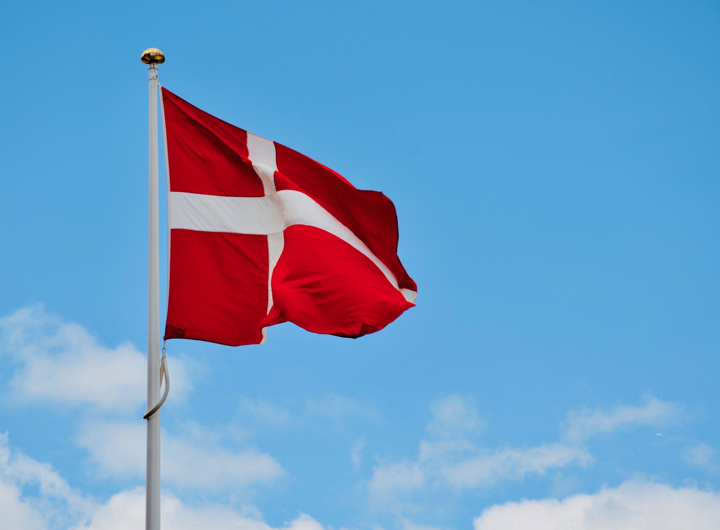 A Danish flag flies proudly in Copenhagen.