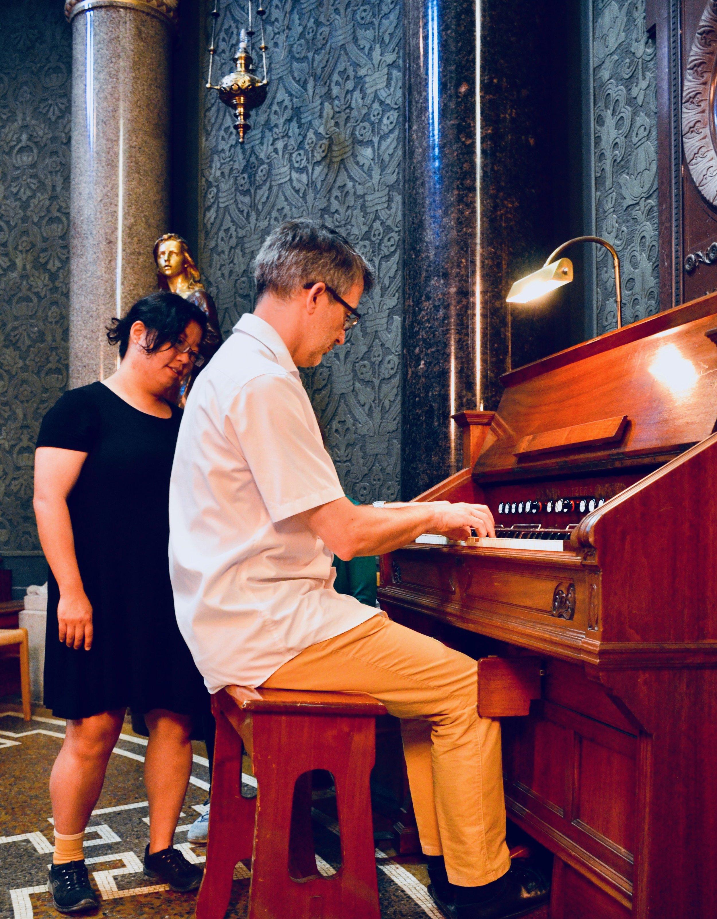 Sven Verner Olsen demonstrates one of Jesuskirke's many harmoniums.