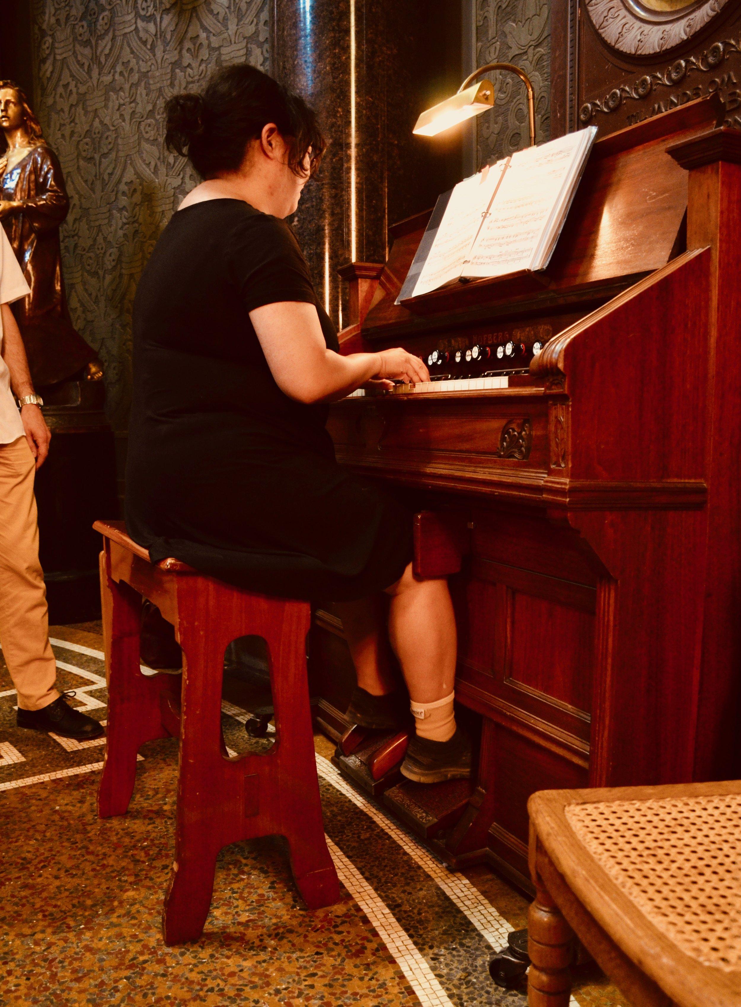 Jennifer Hsiao tries out one of the many harmoniums in Jesuskirke, Copenhagen.