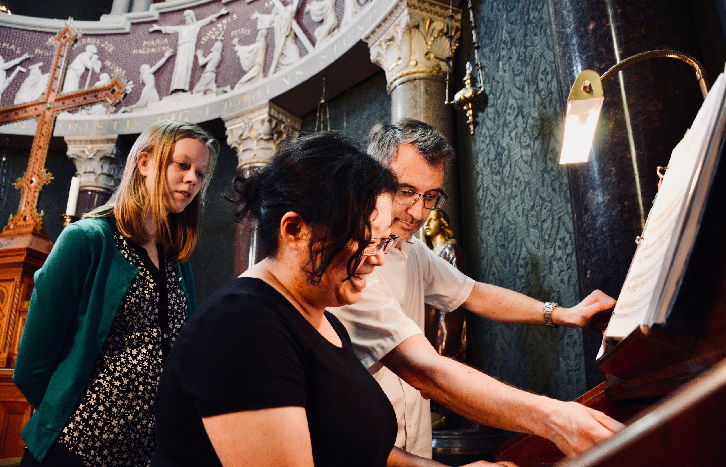 Sven Verner Olsen assists Jennifer Hsiao at the harmonium, Jesuskirke, Copenhagen.
