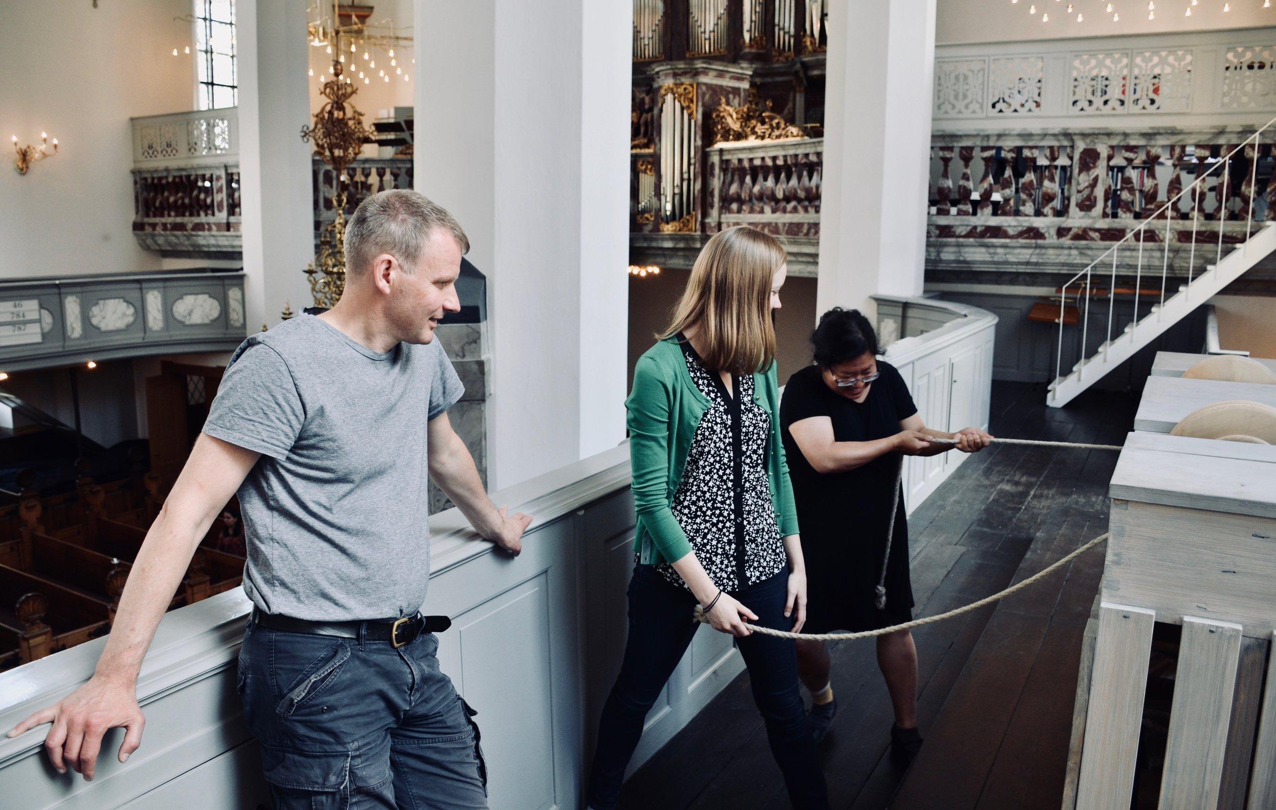 Jennifer Hsiao pumps the bellows for the Italian baroque organ in Trinitatis Kirke, Copenhagen.