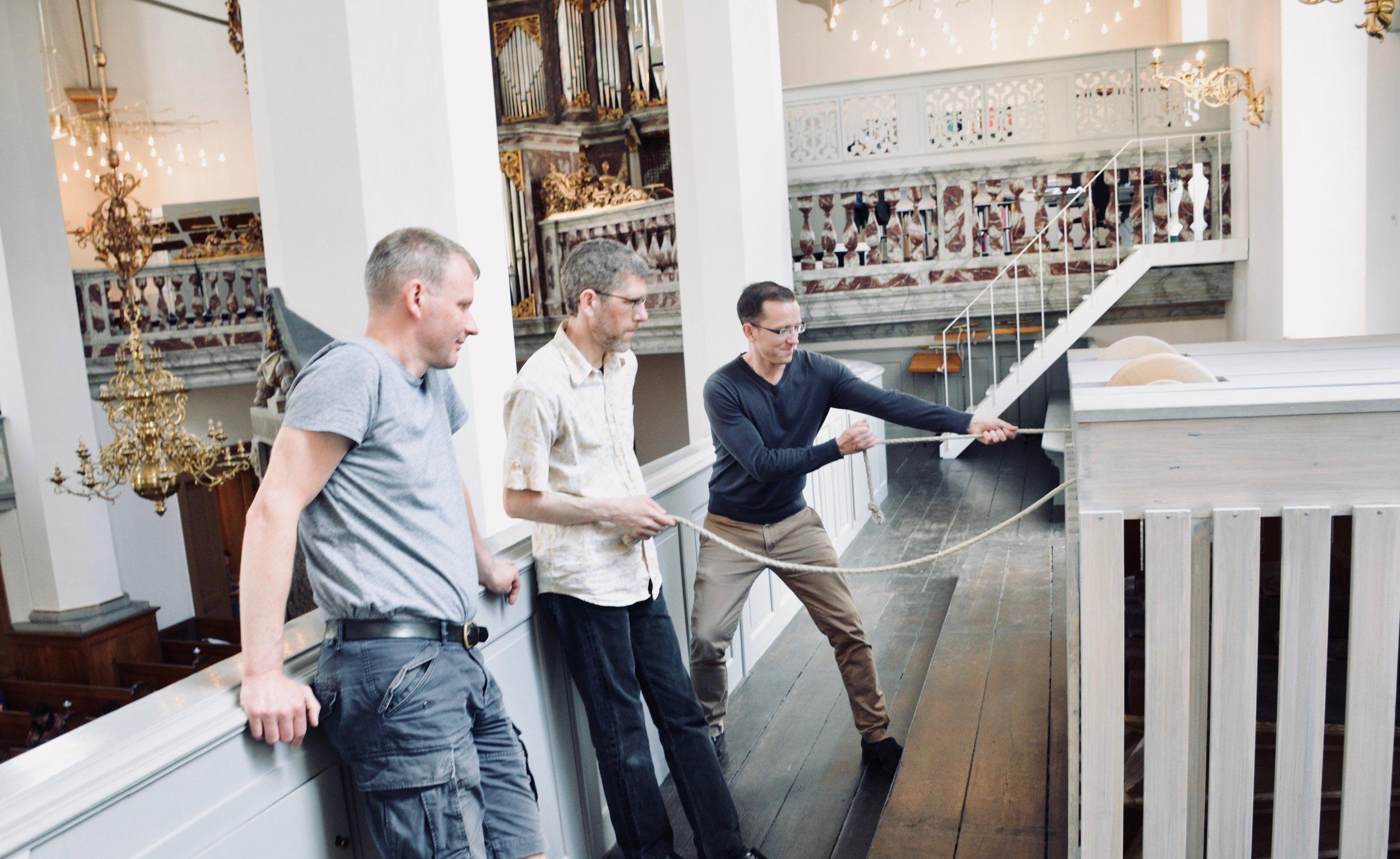 Christian Lane and Chris Porter pump the bellows for the Italian baroque organ in Trinitatis Kirke, Copenhagen.