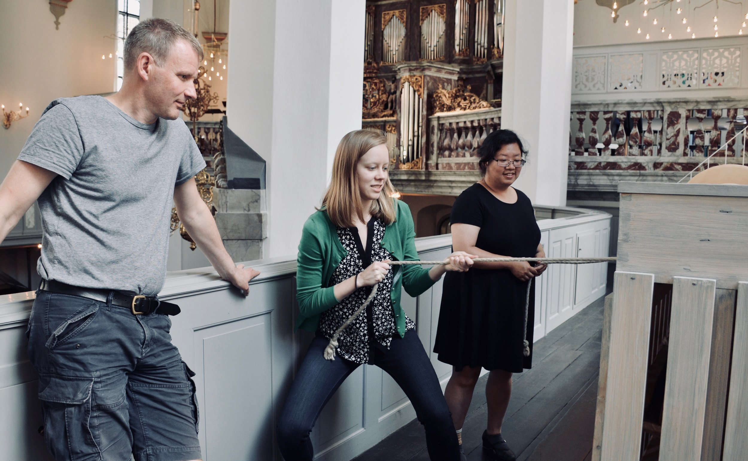 Laura Gullett pumps the bellows for the Italian baroque organ in Trinitatis Kirke, Copenhagen.