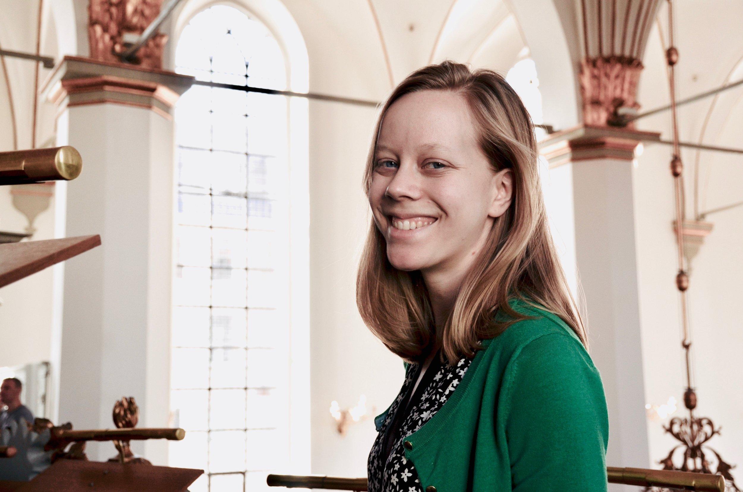 Laura Gullett is all smiles in Trinitatis Kirke, Copenhagen.