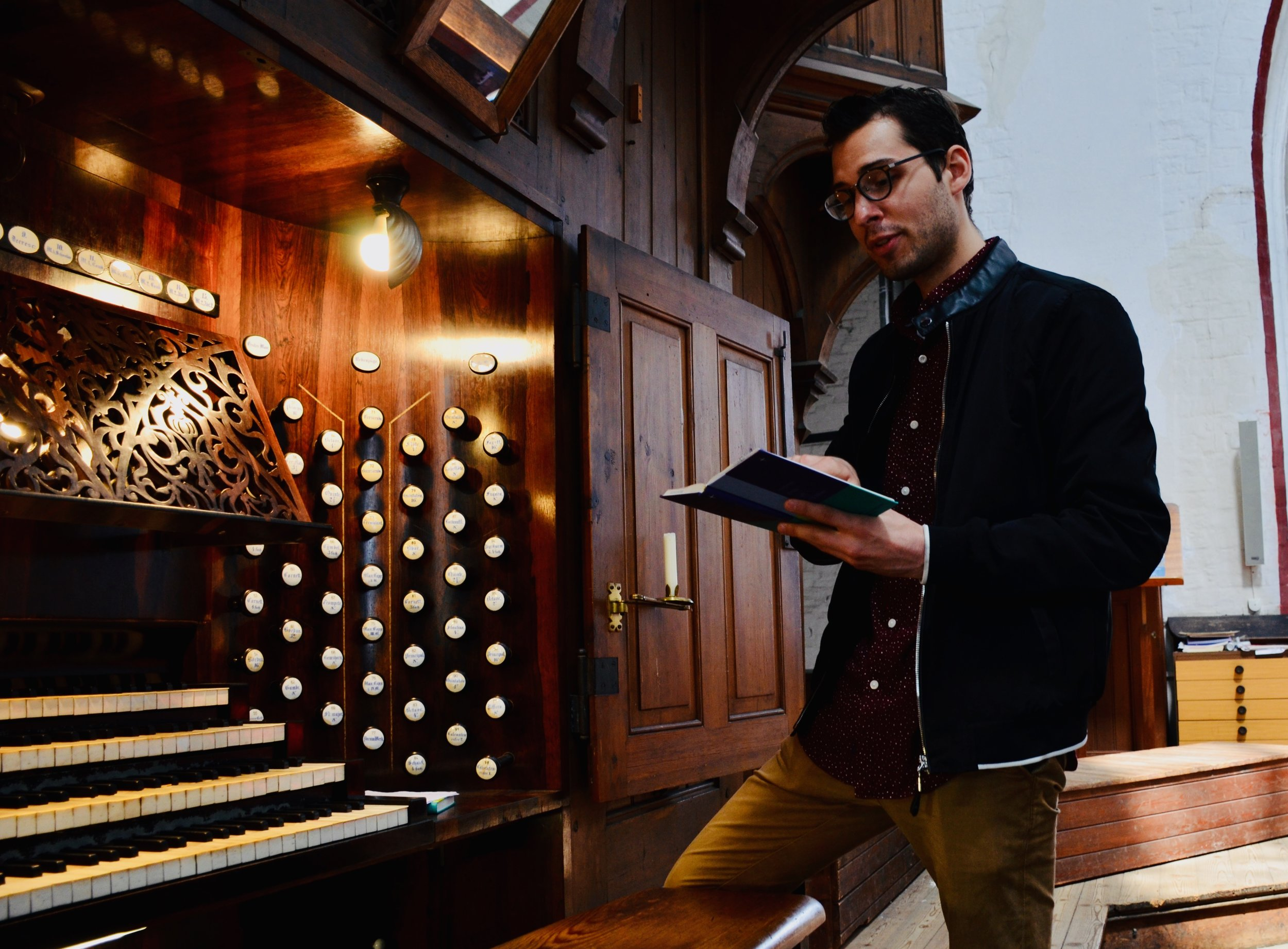 Nick Capozzoli examines the hymnal of 1871 Schwerin Dom.