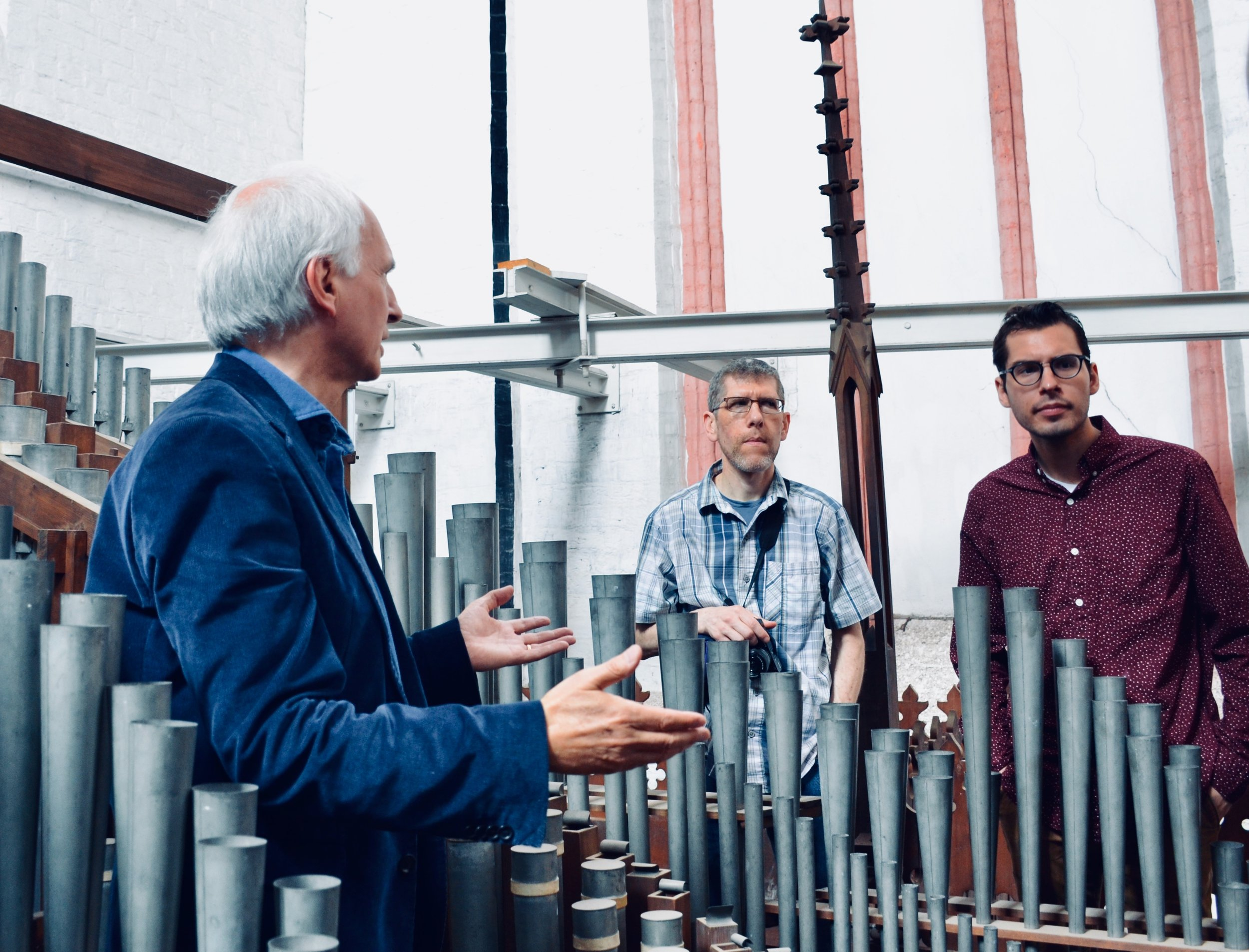 Prof Jan Ernst points out features of the pipework. 1871 Ladegast Organ, Schwerin Dom. Boston Organ Studio.