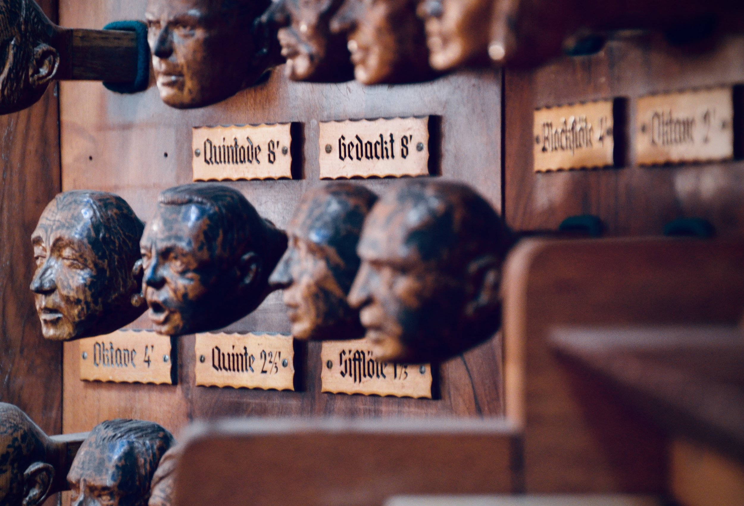 The old organ console of St. Jacobi, Hamburg, features the faces of financial donors carved as stop knobs.