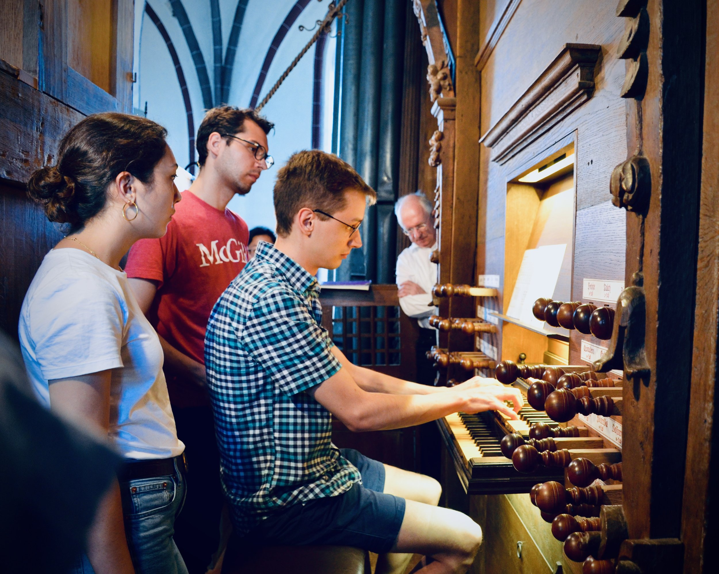 Alex Ross plays the 1624 Scherer organ in Tangermünde, as organist Christoph Lehmann looks on.