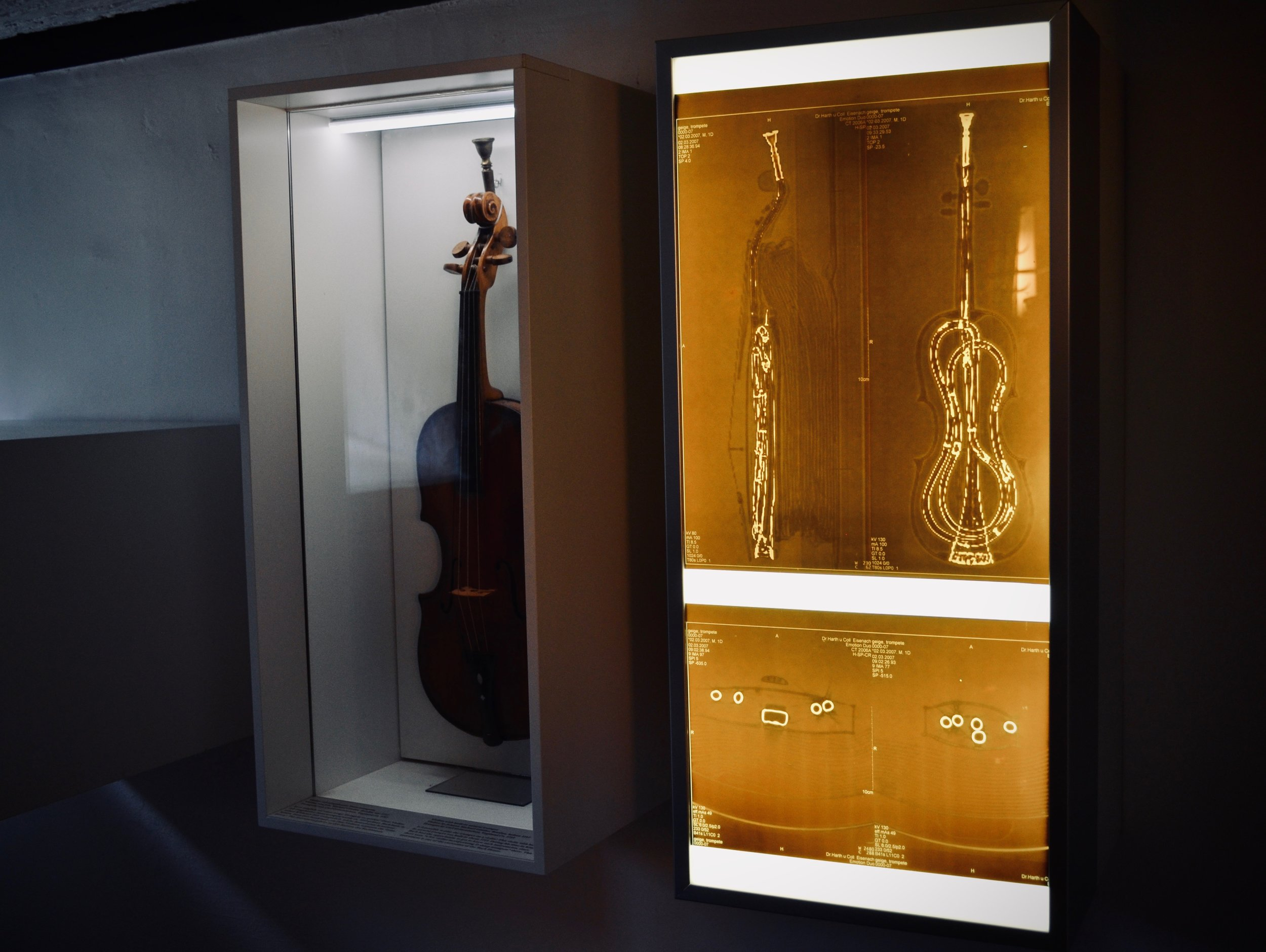 The x-ray shows how the trumpet is placed inside of the violin.