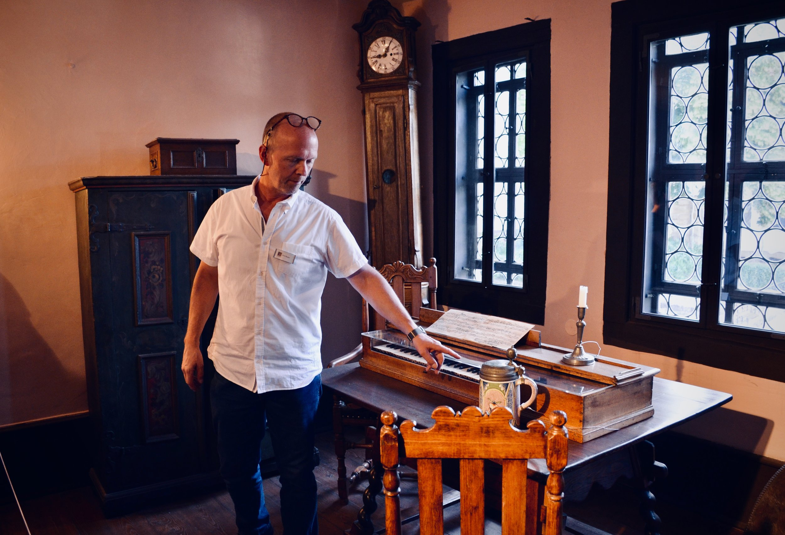 Curator Uwe Fischer shows a reconstruction of Bach's composing studio, with clavichord. The Bachhaus Museum, Eisenach.