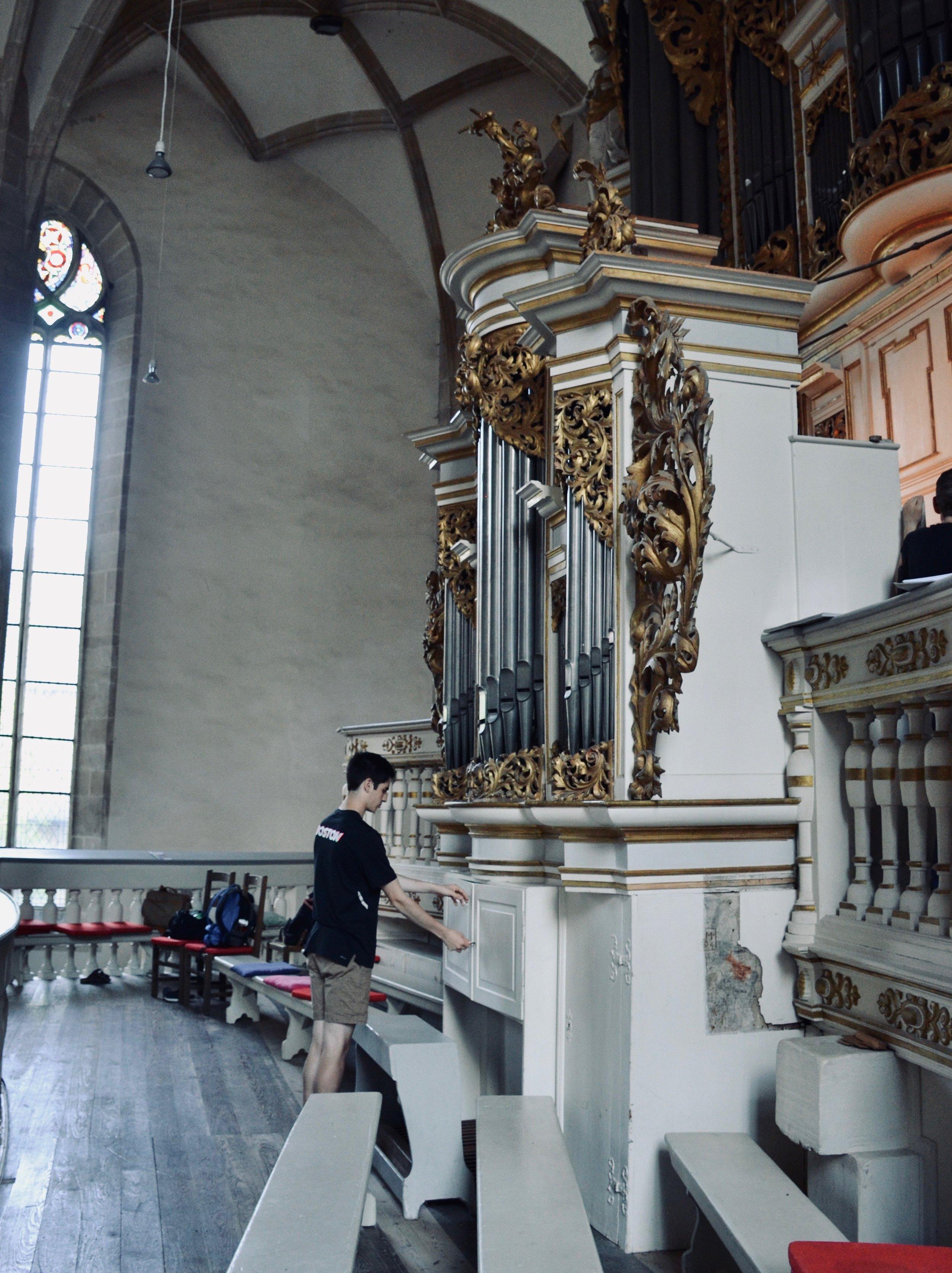 Alex Marin opens the cabinet to the Postiv organ console, 1855 Ladegast Organ, Merseburg Dom.