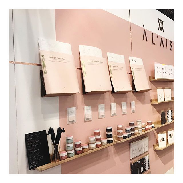 Day 2 @ny_now and a closer look at calligraphy corner and our updated calligraphy workbooks. Translucent pink covers and brass binding. We're in the handmade section, stand 1240b. We'd love to say hi if you're visiting! #nynow #nationalstationeryshow #nss