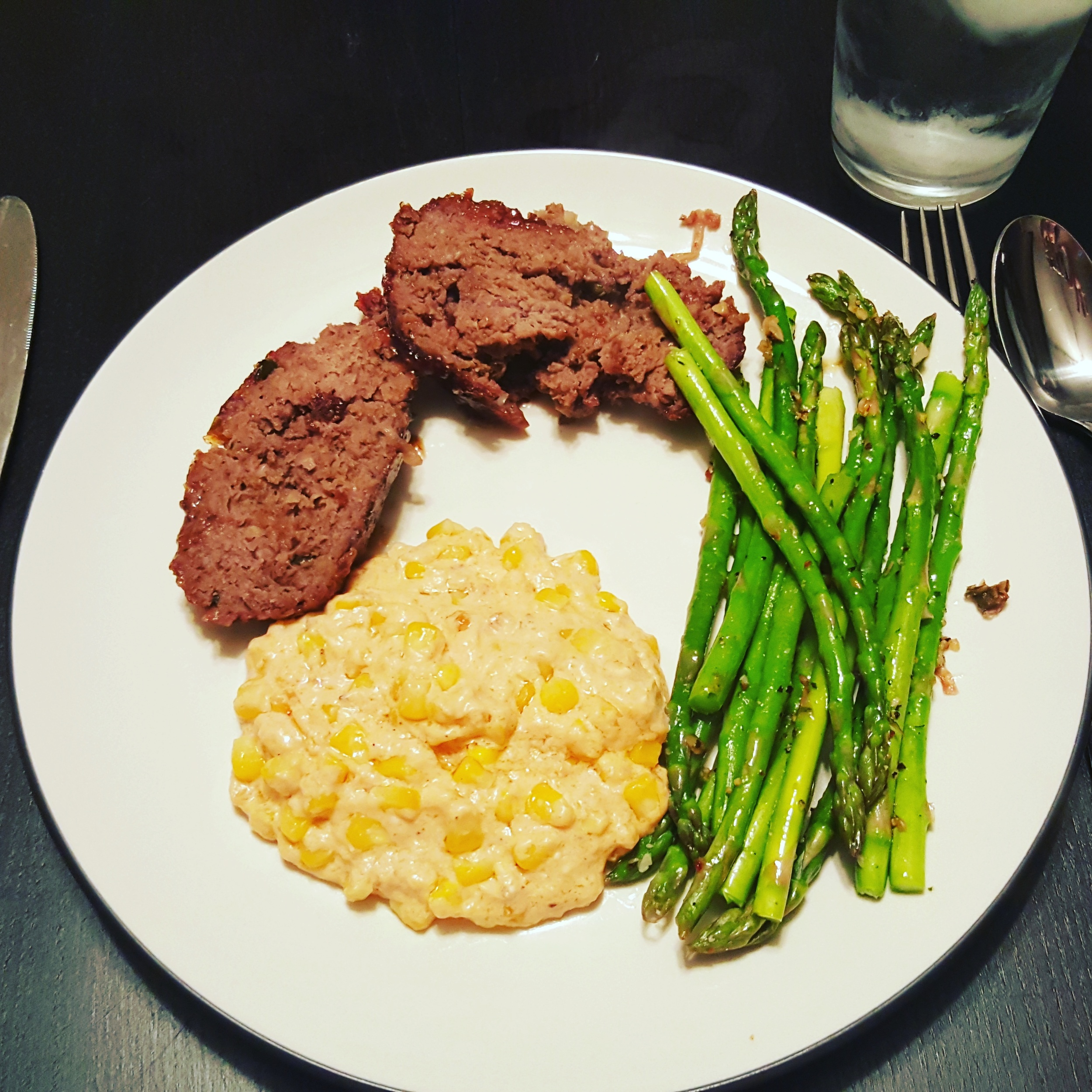 Meatloaf with a brown sugar BBQ bourbon glaze, sauteed asparagus, and cheddar creamed corn