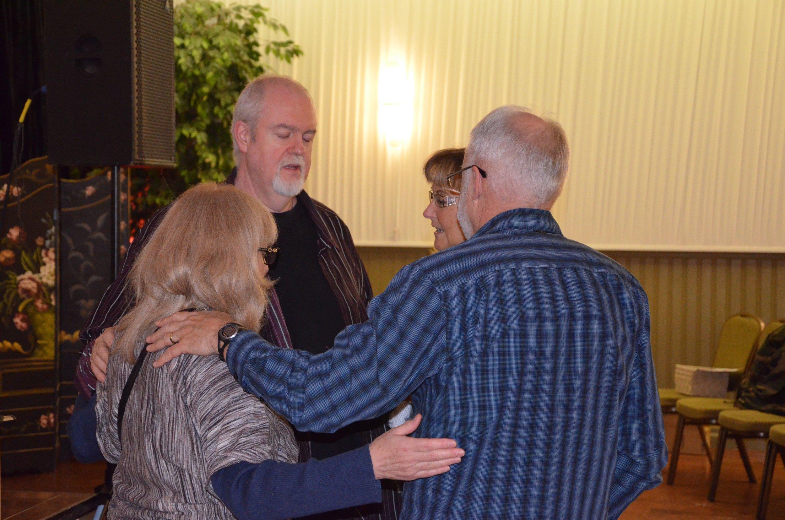 J & C praying with Corinne & John Dinan.jpg