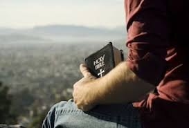 Man with bible.jpg