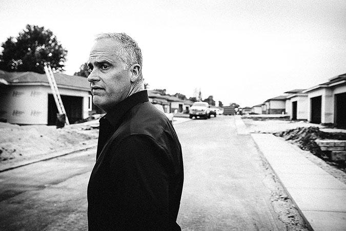 Matt E. Miller walks through Tera Vera, a gated senior living community along Sunset Street.