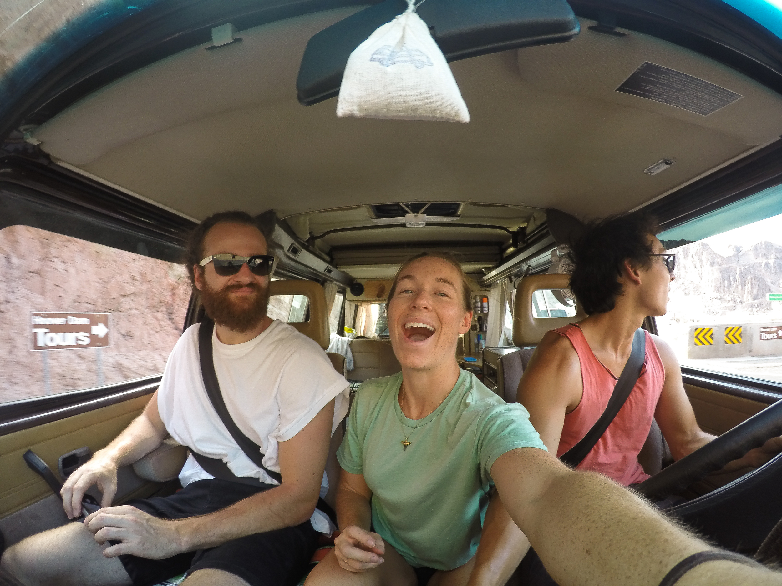Bartos, MAK, & Owen driving into the Hoover Dam after our longest and hottest break down. Only 118 degrees.