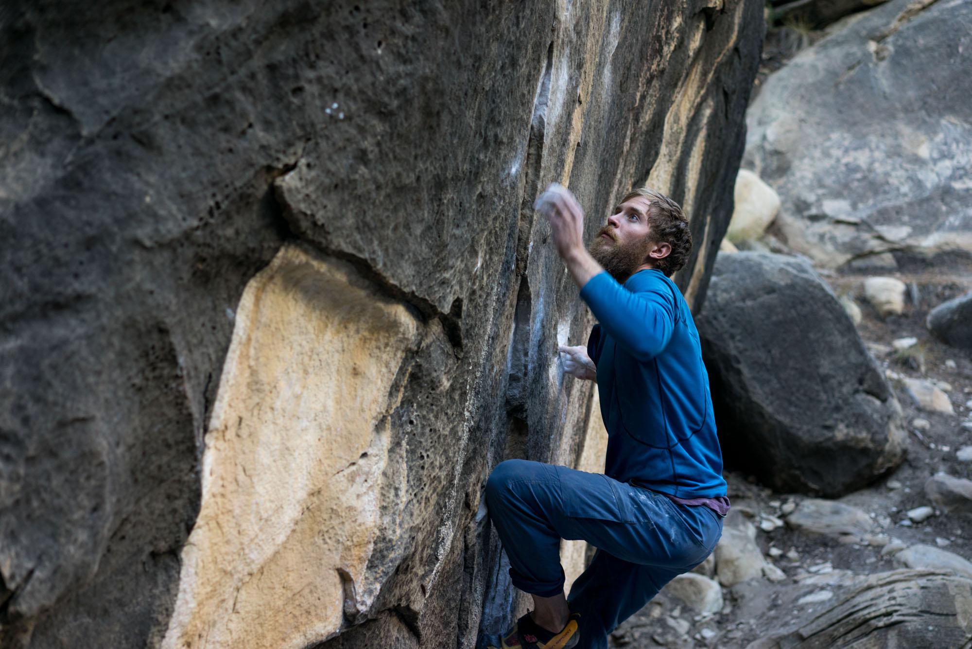 Thomas wrestling a boulder in Joe's Valley
