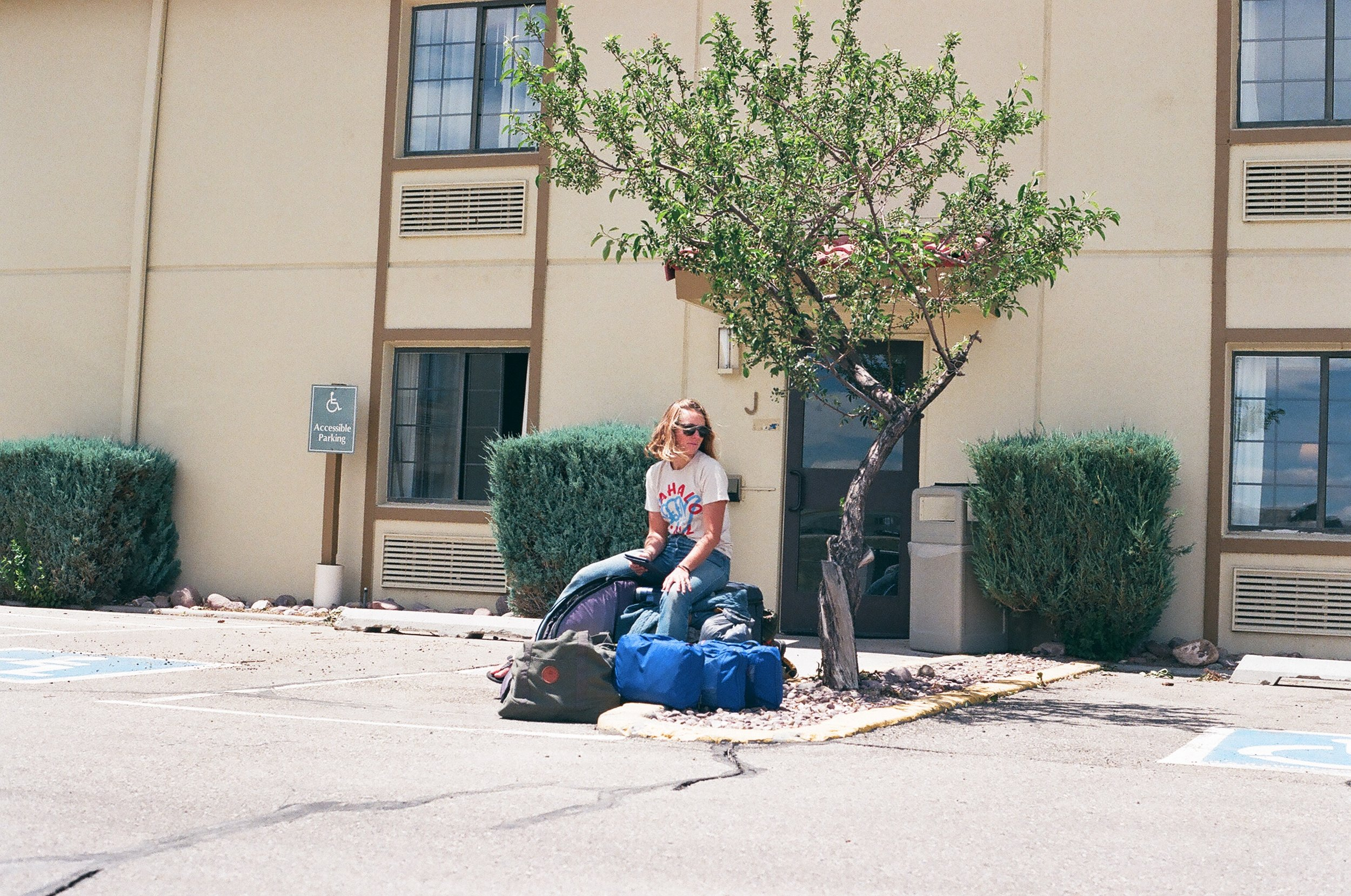 MAK hanging out with all of our belongings outside of our hotel room, 35mm