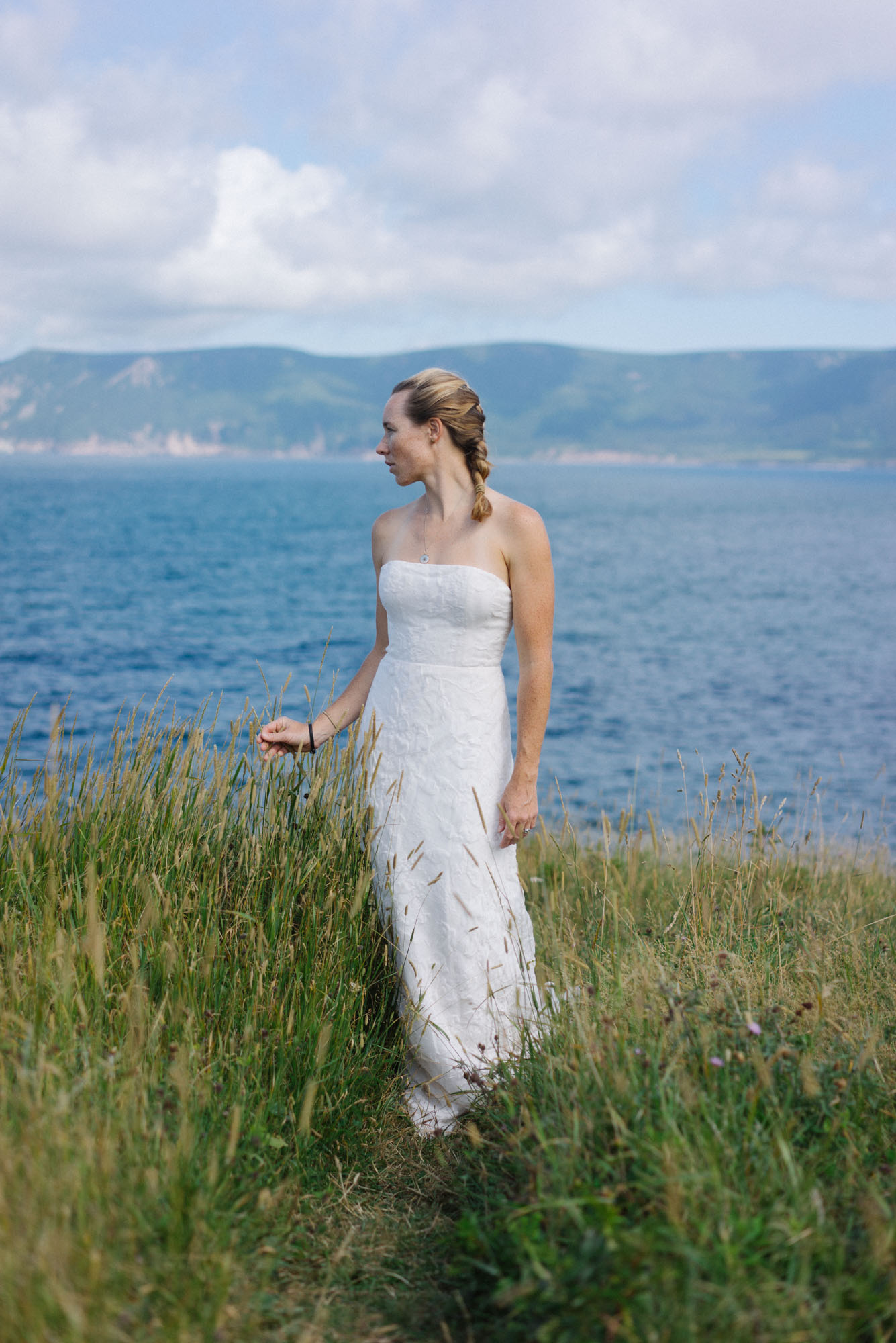 MAK modeling a   wedding dress (The Law)   on the side of the road out of Meat Cove