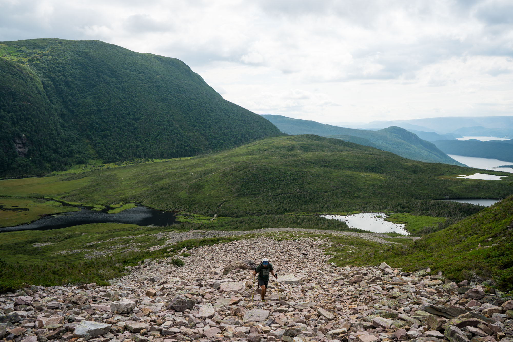 Owen starting the trail up to the summit of Gros Morne via the rocky mountain side