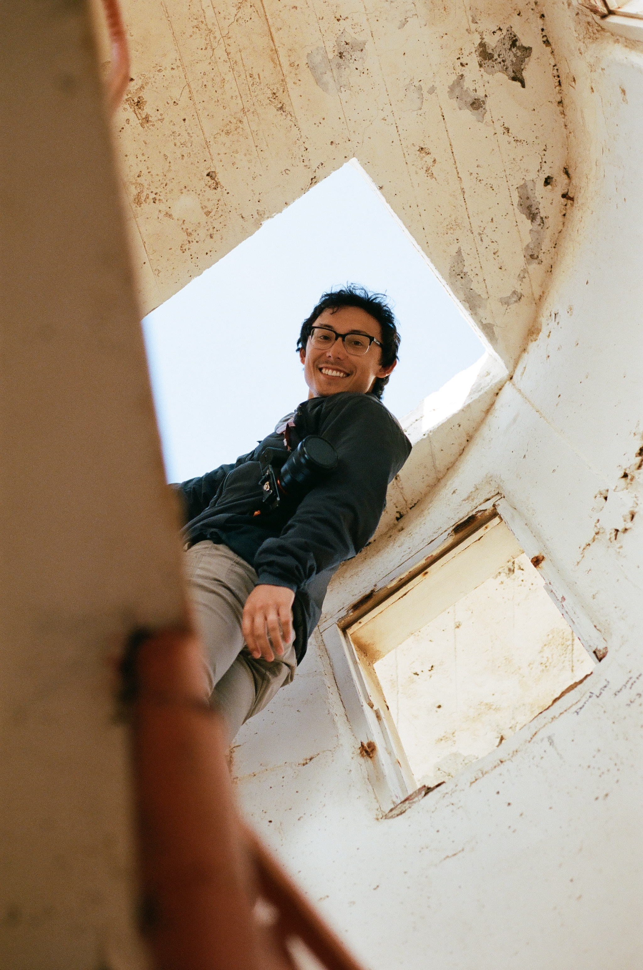 Owen climbing to the top of the lighthouse, 35mm