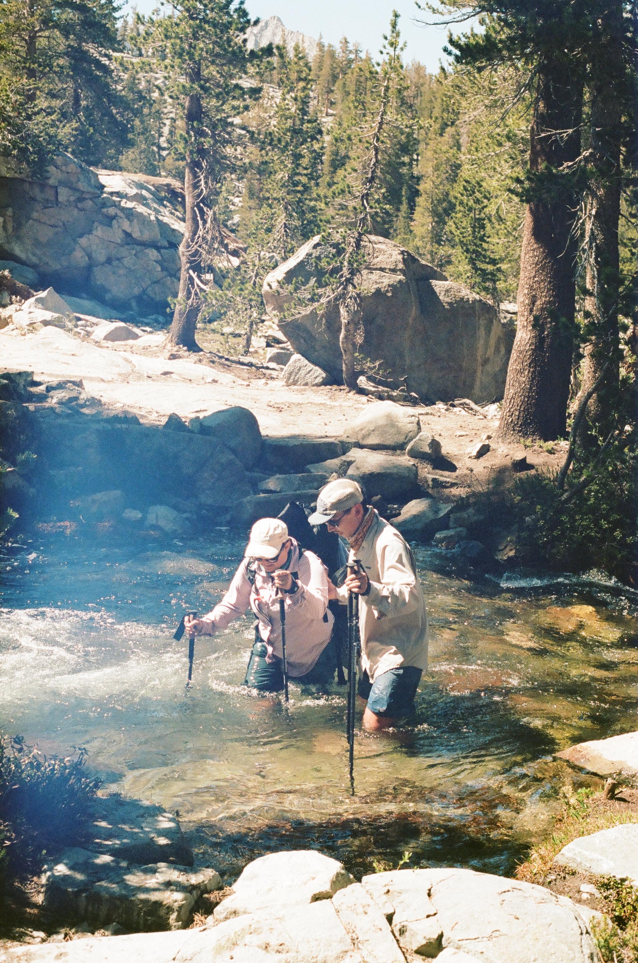 Owen helping Sissy ford a creek near Island Pass, 35mm film