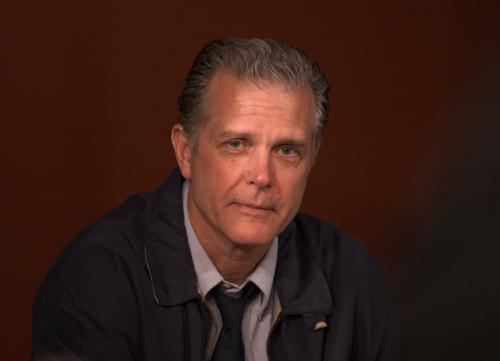 Inspector Ascher (Richard Shoberg)