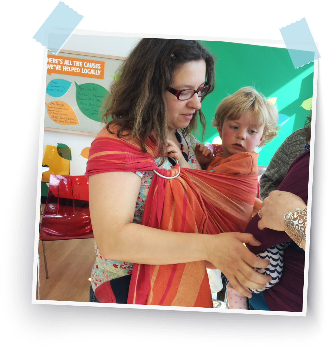 Ina carrying her toddler in a ring sling