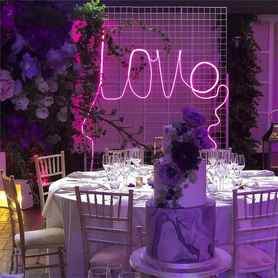 "- Charlotte Loves… ""Dita our neon 'Love' mounted on her white washed 8ft frame. I absolutely love the edgy look that Dita brings to any venue - the reaction she gets when people see her for the first time is what makes her so special for me."""
